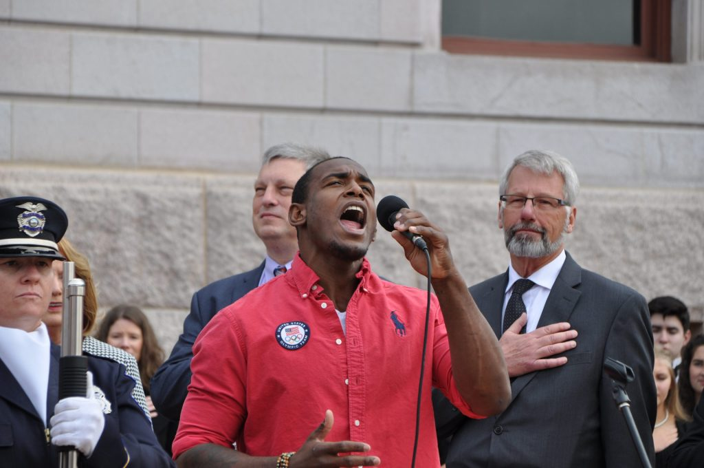 "U.S. Olympic wrestler J'Den Cox sang the national anthem at the swearing-in ceremony. Olympians were included in the program in honor of the city's ""Olympic City, USA"" branding campaign."