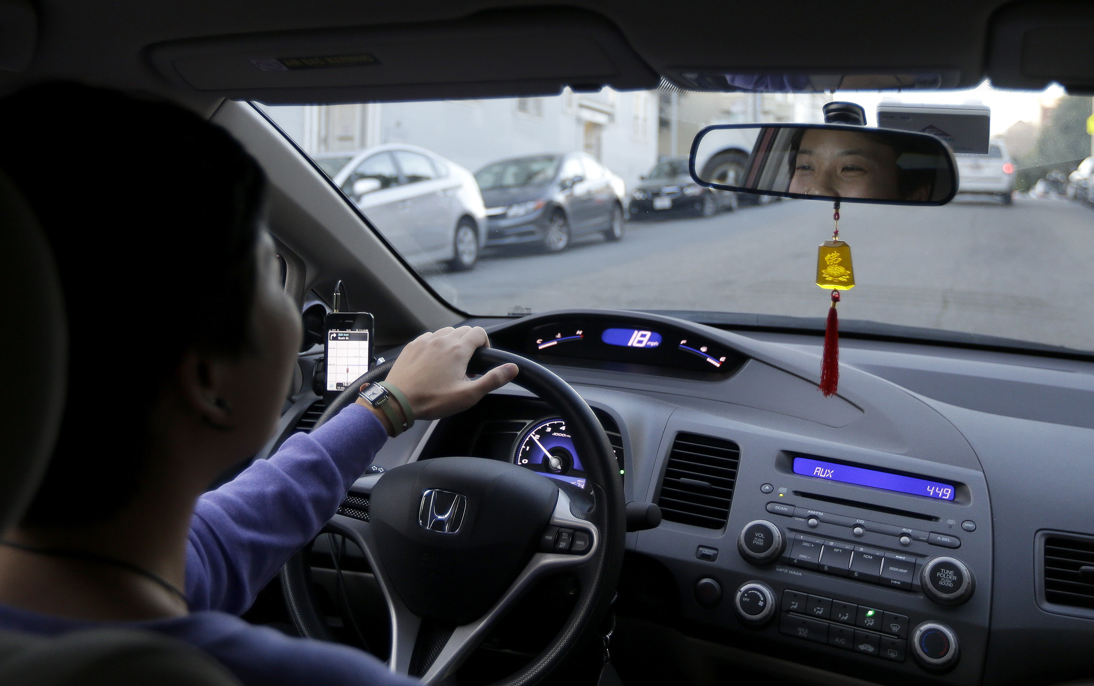 <p>Lyft driver Nancy Tcheou drives through San Francisco in a file photo. </p>