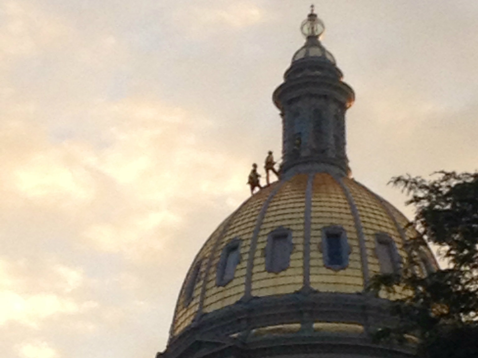 <p>Gilders rappel down the Colorado state Capitol's dome on Wednesday, Aug. 13, 2014.</p>