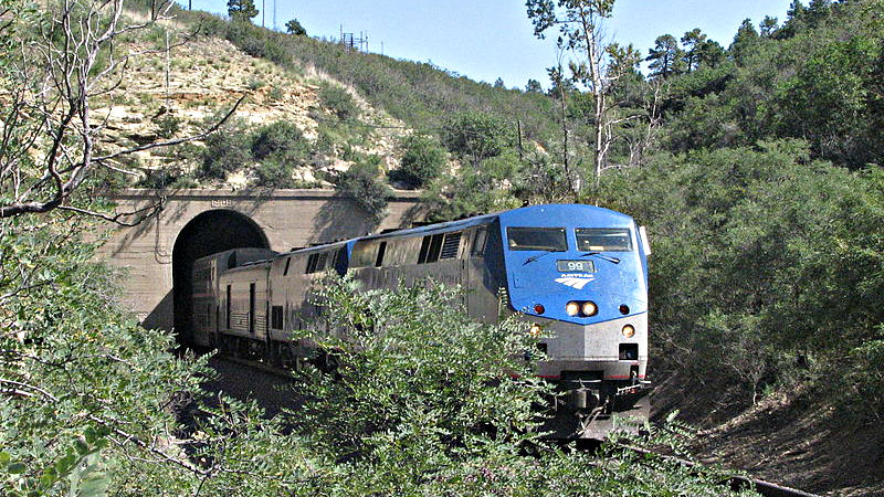 "<p><span style=""font-family: sans-serif;font-size: 13px;line-height: 16.714229583740234px"">Amtrak engine 99 pulls the westbound Southwest Chief out of the Raton Tunnel near the summit of Raton Pass.</span></p>"