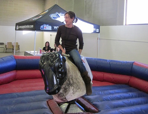 <p>CPR's Lesley McClurg on a mechanical bull at the National Western Stock Show</p>