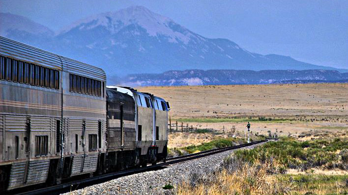 <p>The Southwest Chief rail line, just east of Trinidad, Colo. The Sangre de Cristo mountain range looms in the distance.</p>