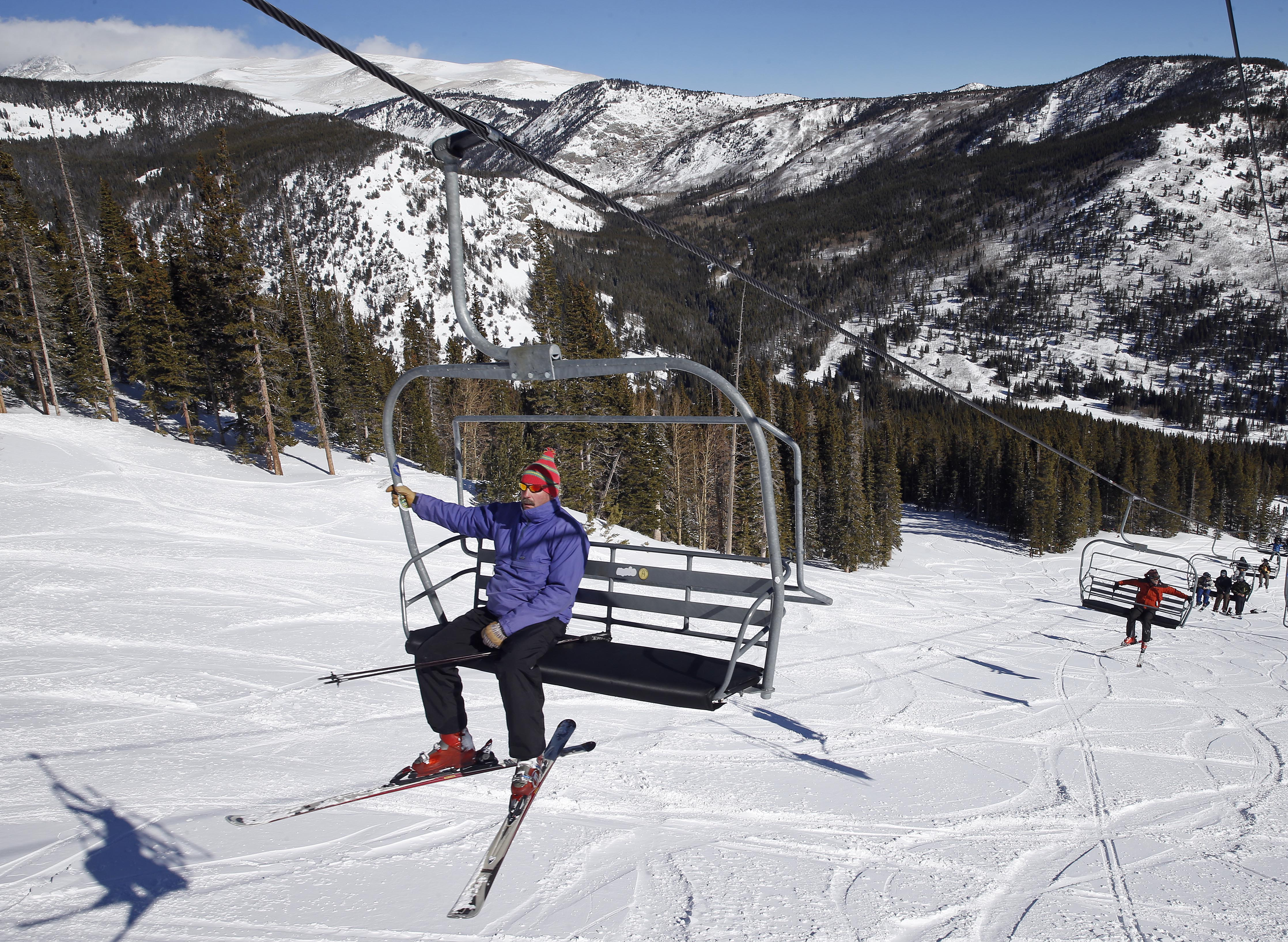 <p>A skier rides the lift on Corona Bowl, known for its extreme skiing, at Eldora Mountain Resort, near Nederland, Colo.</p>