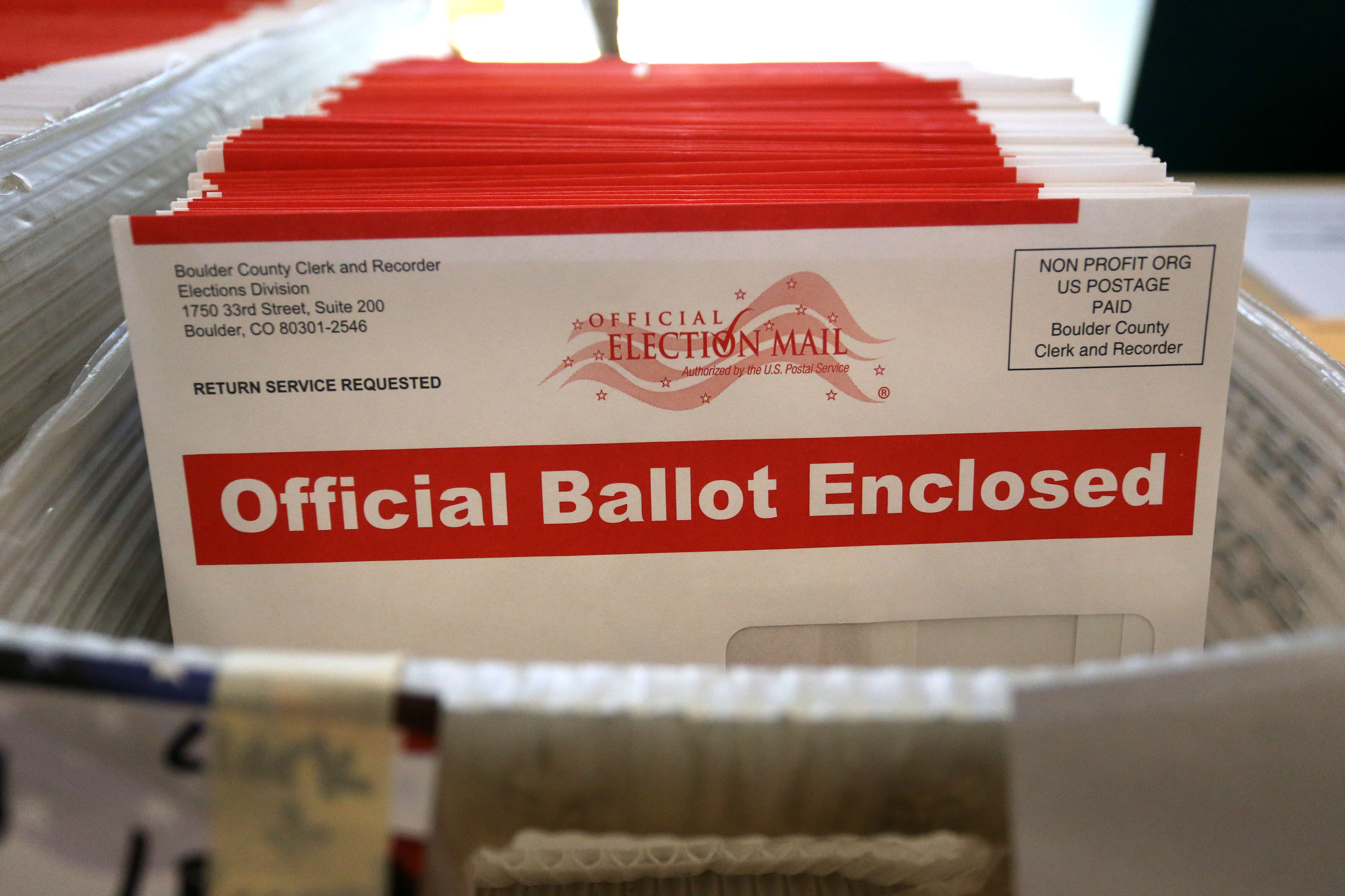 Ballots envelopes sit in a bininside a polling center at the Boulder County Clerk and Recorder's officeon Election Day 2014.