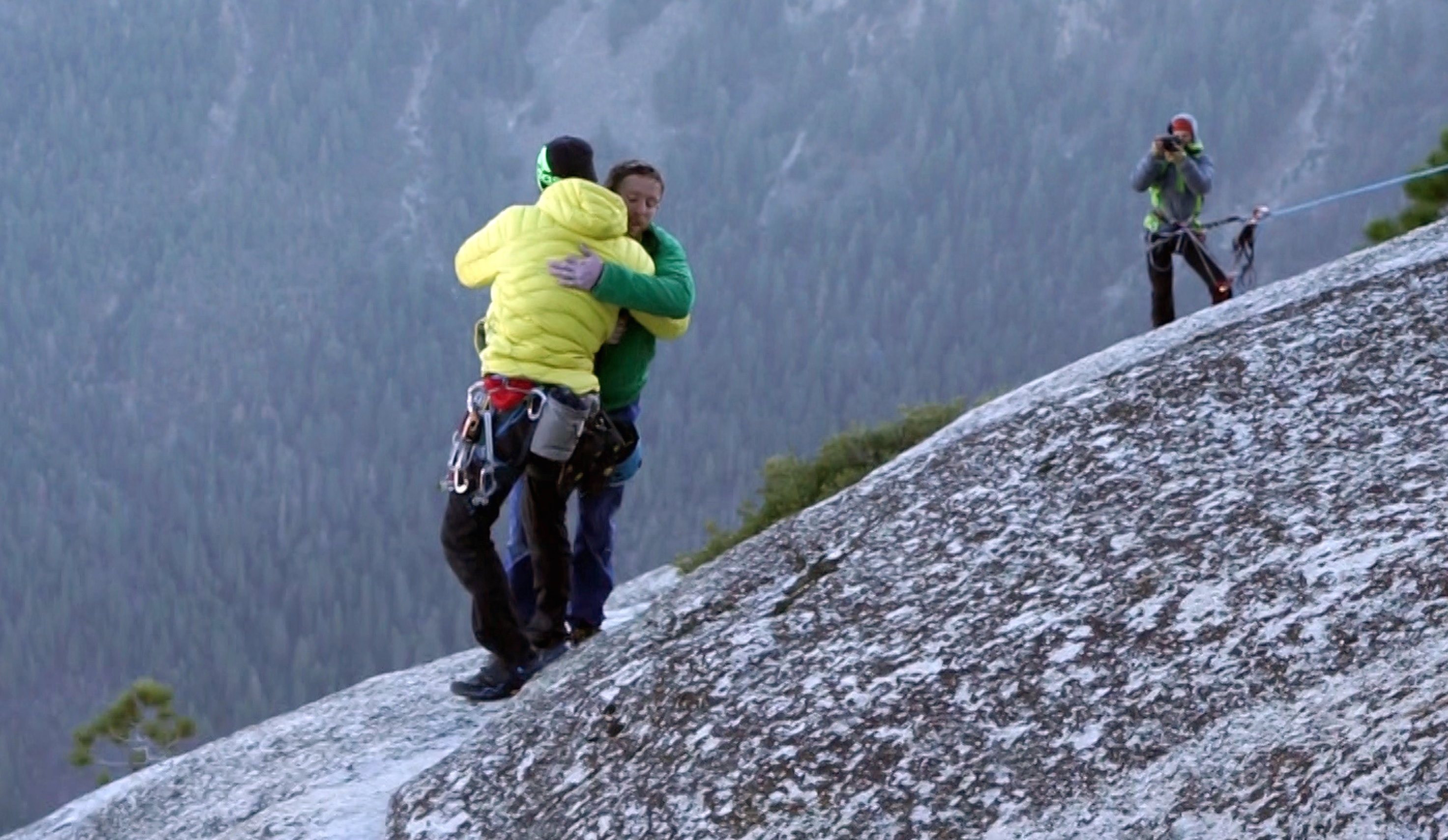 <p>Kevin Jorgeson, left, and Tommy Caldwell embrace each other after reaching the top of El Capitan, a 3,000-foot sheer granite face in Yosemite National Park, Calif. </p>
