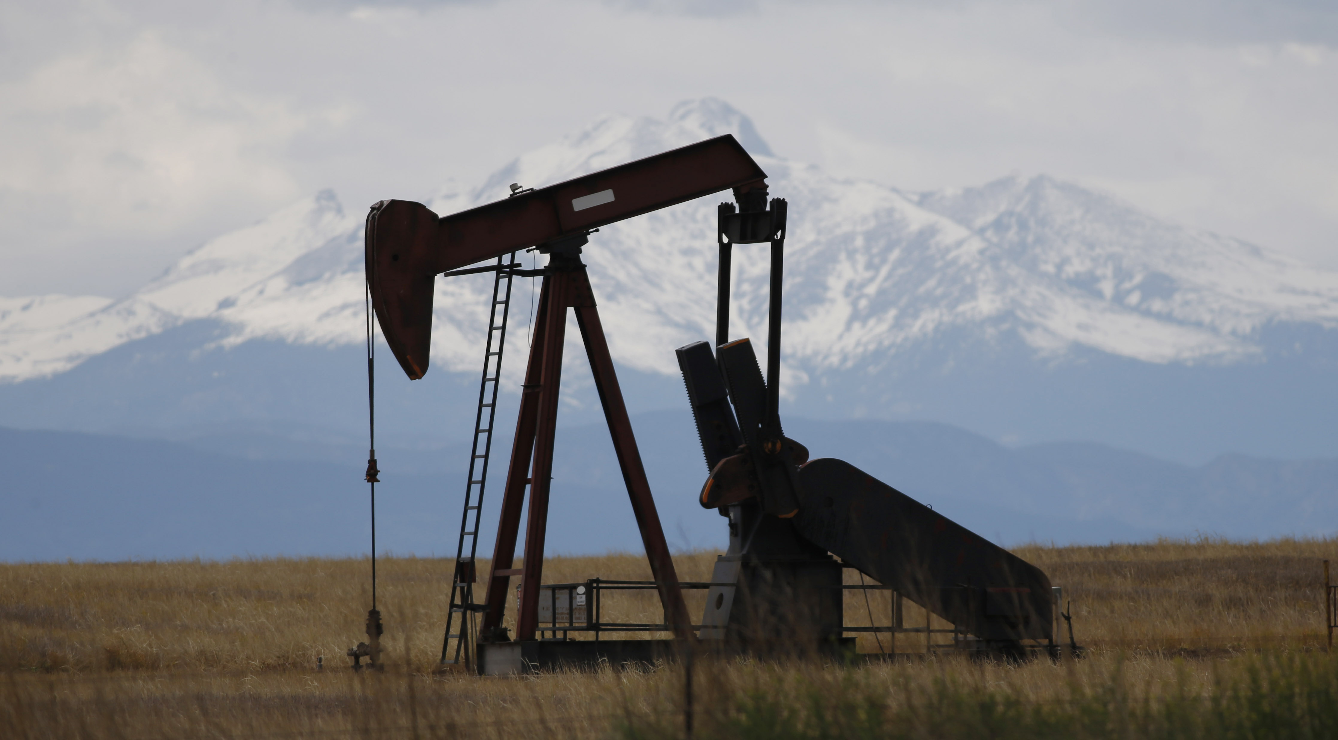 <p>In this May 2016, photograph, a pump jack works off state Highway 119 near Firestone, Colo. </p>
