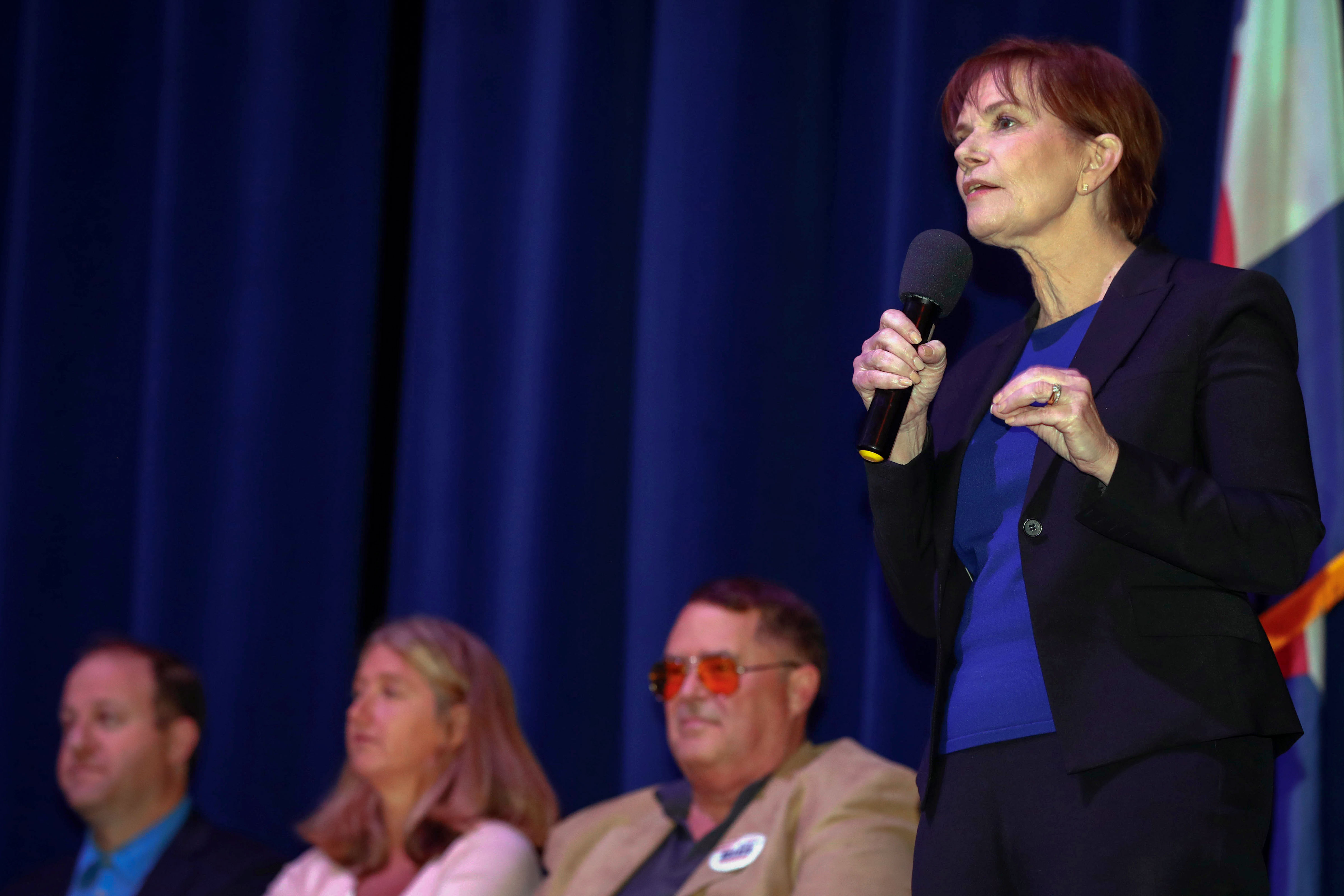 <p>Colorado Lt. Governor Donna Lynne, right, makes a point during a governor candidate debate sponsored by Never Again Colorado at Manual High School Saturday, May 19, 2018, in Denver. </p>