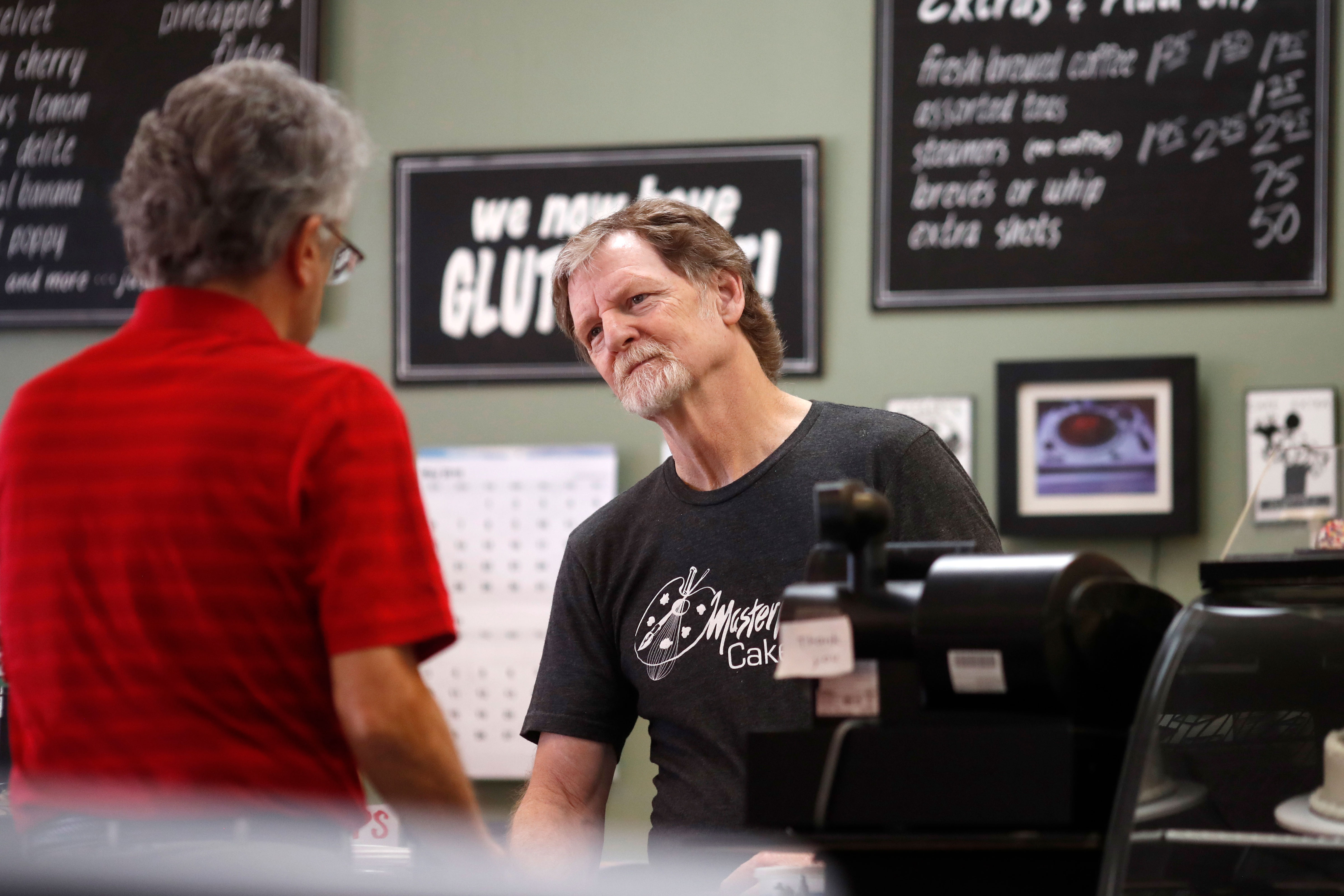 <p>Baker Jack Phillips, owner of Masterpiece Cakeshop, right, manages his shop Monday, June 4, 2018, in Lakewood, Colo.</p>
