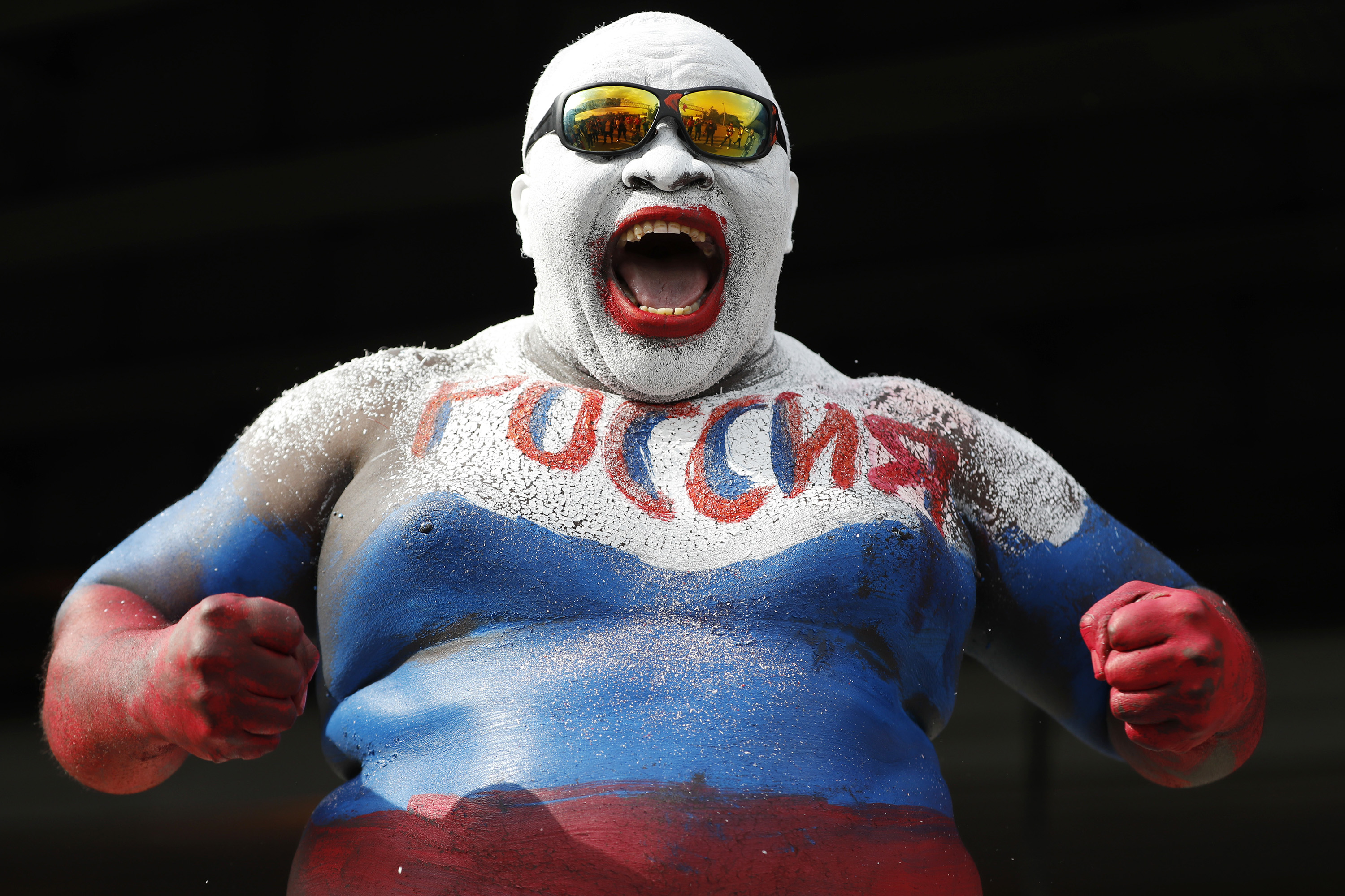 <p>Rigobert Youmbi from Cameroon strikes a pose wearing body paint in the Russian team's colors prior to the 2018 soccer World Cup opening match between Russia and Saudi Arabia at the Luzhniki Stadium in Moscow, Russia. </p>