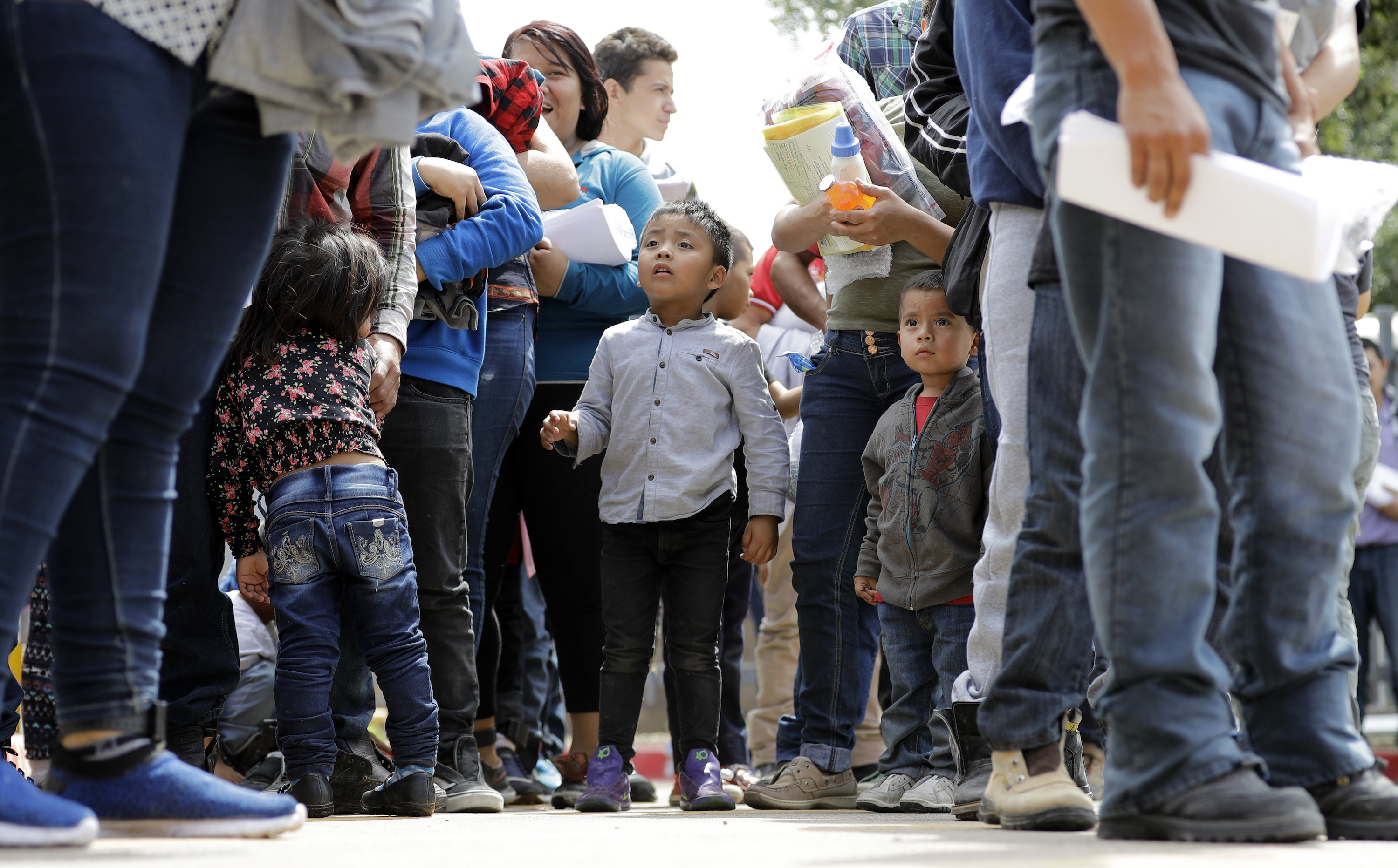 <p>Immigrant families line up to enter the central bus station after they were processed and released by U.S. Customs and Border Protection, Sunday, June 24, 2018, in McAllen, Texas. </p>
