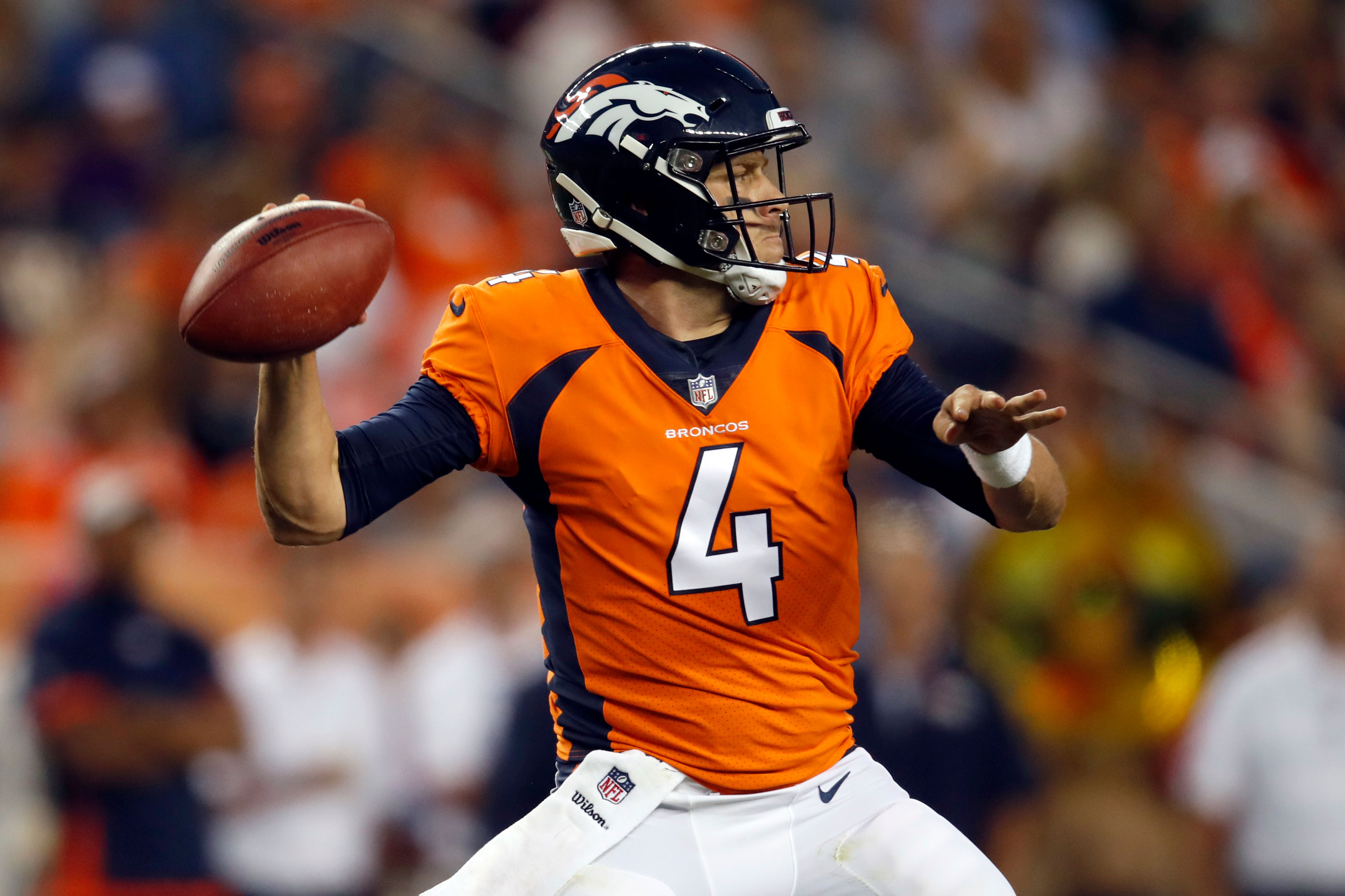 <p>Denver Broncos quarterback Case Keenum (4) throws against the Chicago Bears during the first half of a preseason NFL football game, Saturday, Aug. 18, 2018, in Denver.</p>