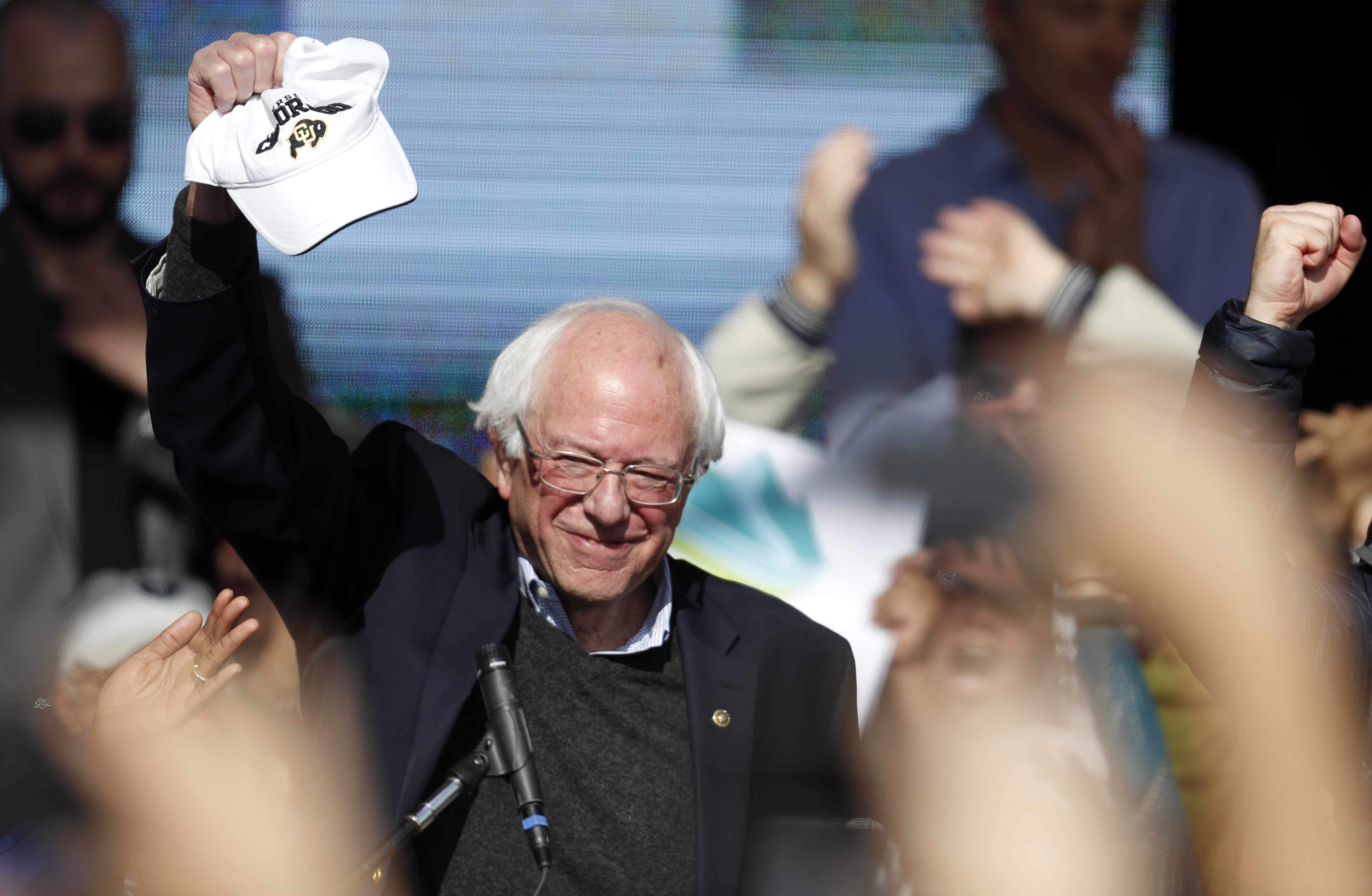 <p>U.S. Senator Bernie Sanders hoists a CU Buffs hatduring a rally with young voters on the campus of the University of Colorado Wednesday, Oct. 24, 2018, in Boulder, Colo.</p>