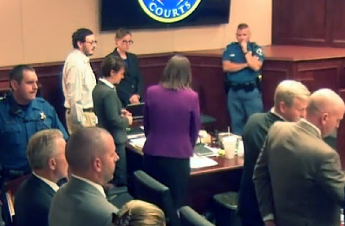 <p>Aurora theater shooter James Holmes, top third from left in light-colored shirt, stands for the entrance of the jury, inside Arapahoe County District Court. </p>