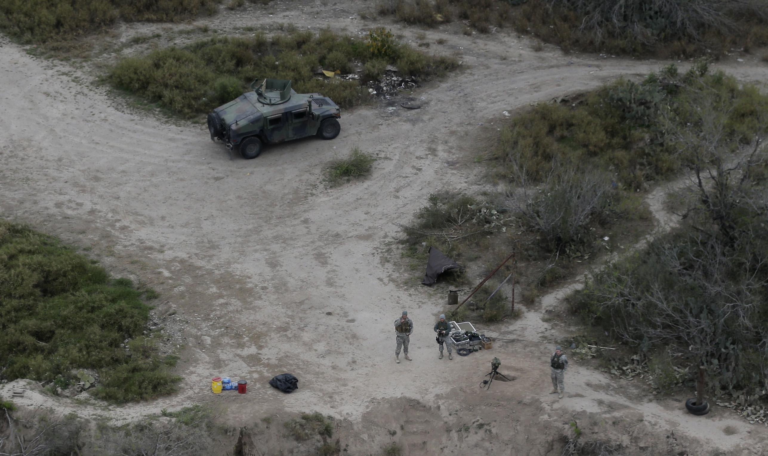 <p>Members of the National Guard patrol along the Rio Grande at the Texas-Mexico border, Tuesday, Feb. 24, 2015, in Rio Grande City, Texas.</p>