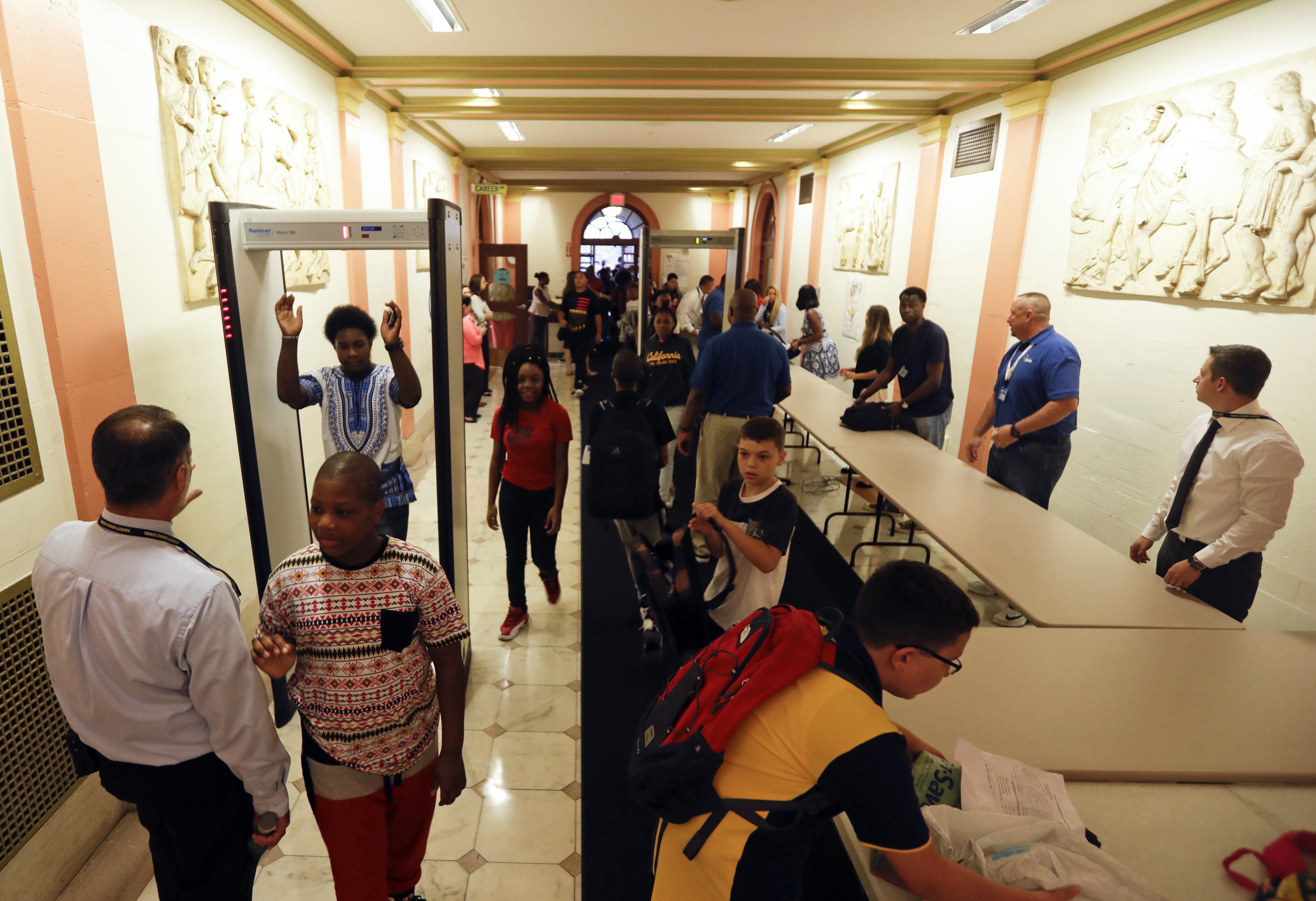 <p>Students at William Hackett Middle School pass through metal detectors on the first day of school on Tuesday, Sept. 6, 2016, in Albany, N.Y. Schools in Colorado are considering similar security measures for the 2018-19 school year.</p>  <p></p>