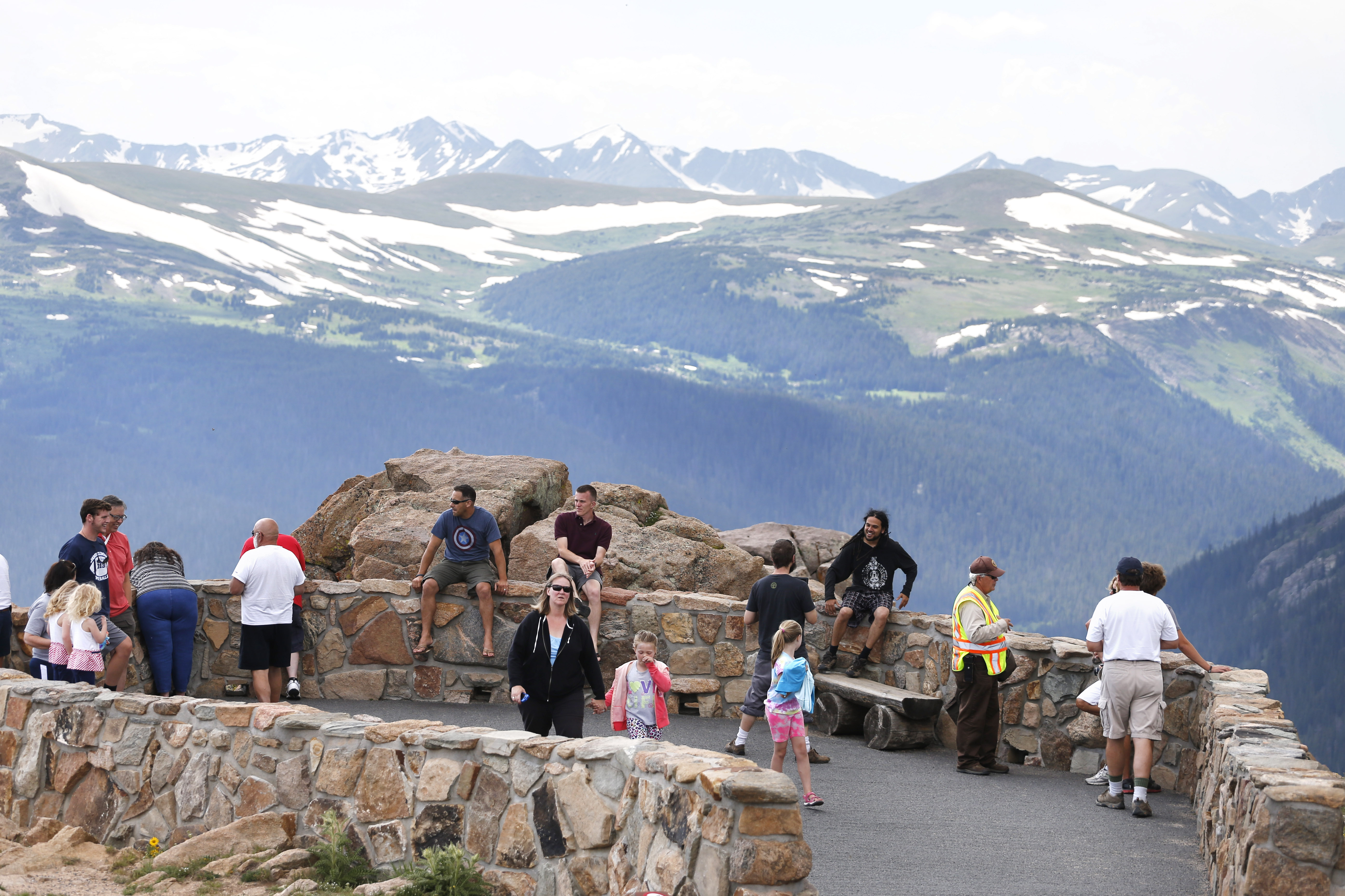 <p>Visitors take in a scenic overlook off Trail Ridge Road, above tree-line at Rocky Mountain National Park, west of Estes Park, Colo., Monday, July 14, 2014.</p>