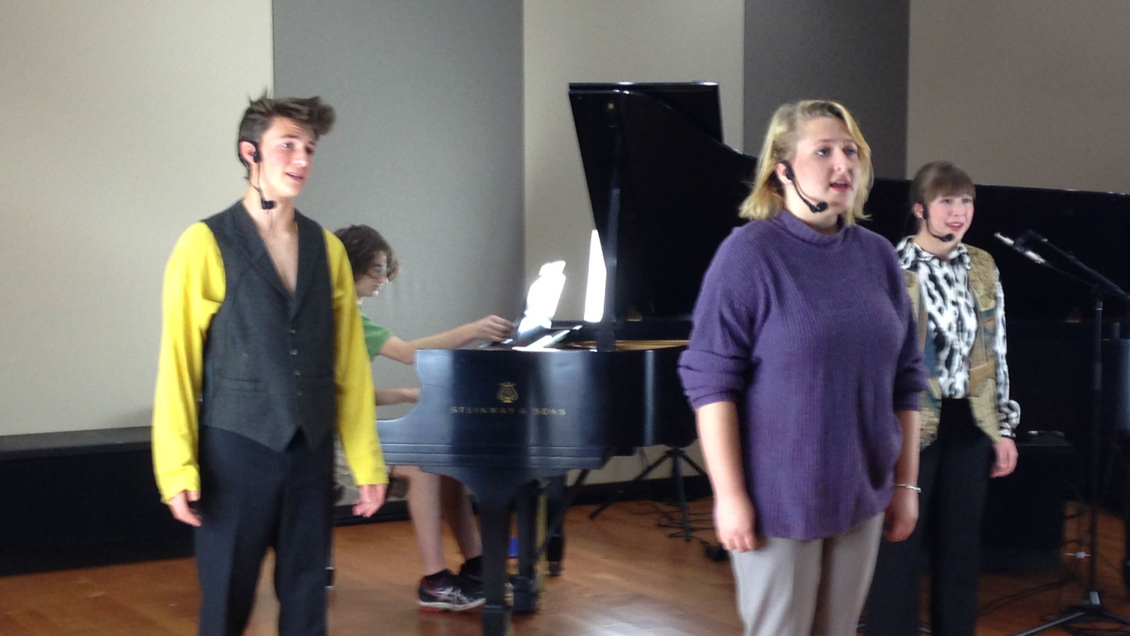 """<p>Left to right: Solomon Abell, Elise Falkenstein and Mikayla Aiken perform the song """"Trio"""" from """"Balloon Boy: The Musical"""" in the CPR Performance Studio. The show's music director,Oliver Ullman, is on the piano.</p>"""