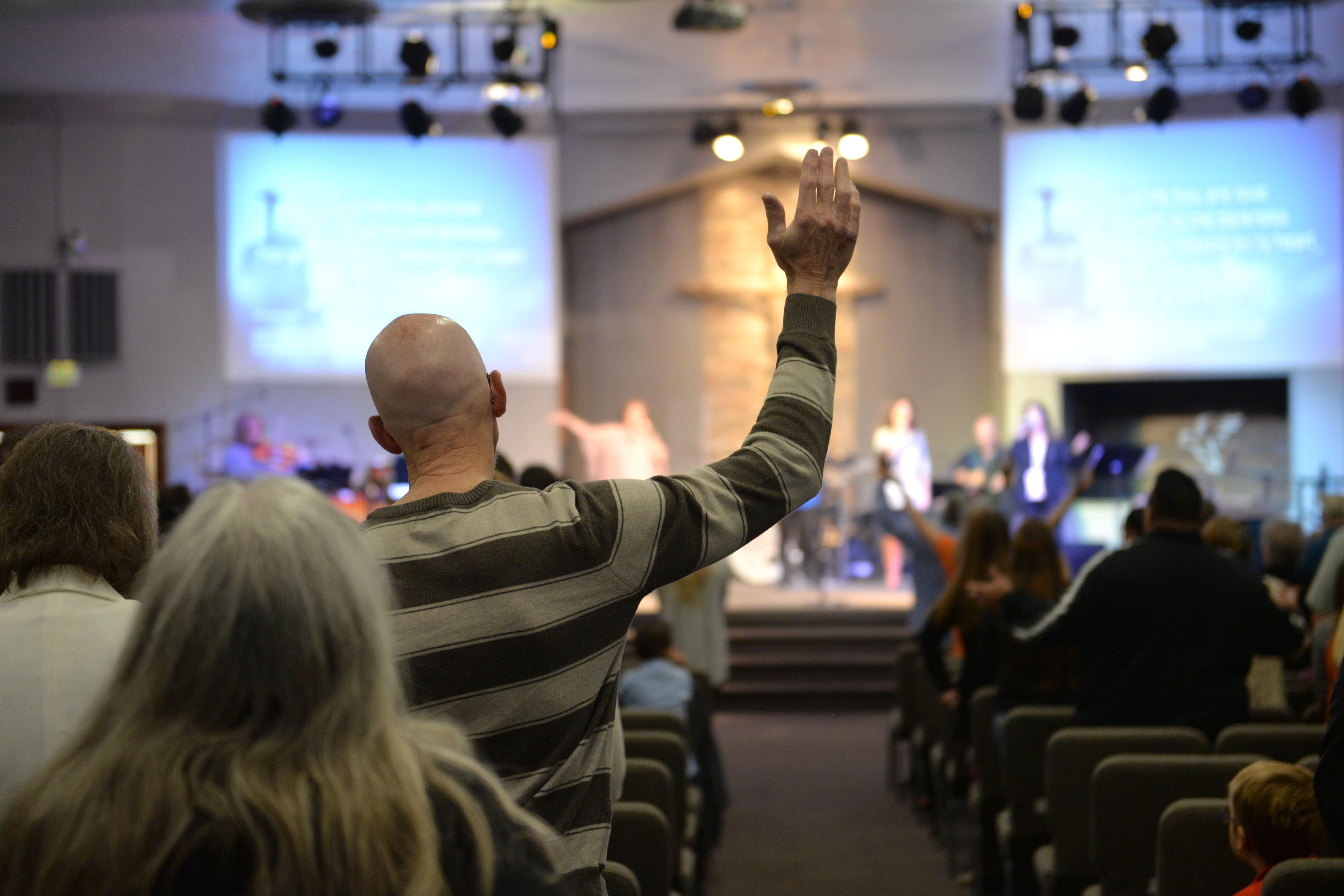 <p>Worshipping at Agape Fellowship church in Pueblo.</p>