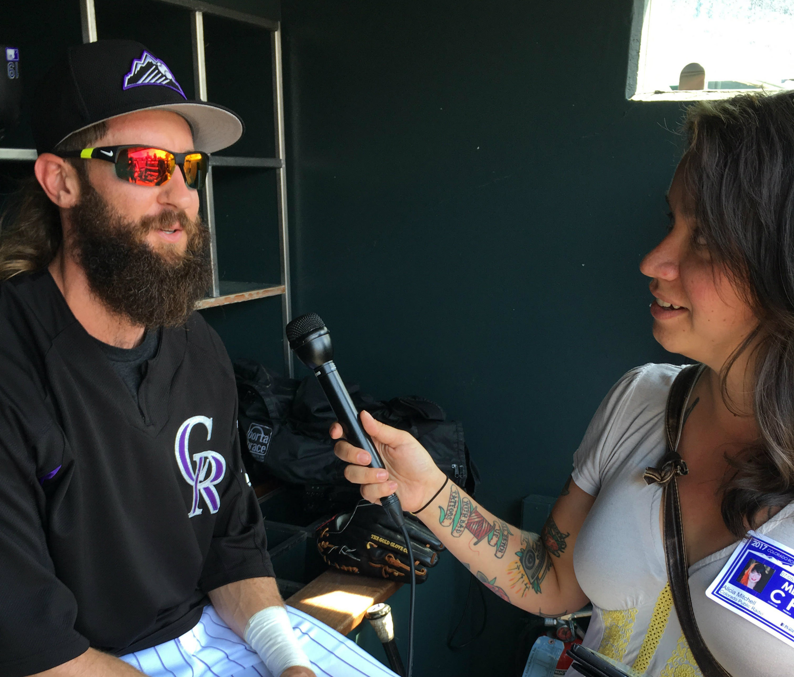 <p>Rockies center fielder Charlie Blackmon talks with Alicia Bruce Mitchell in the Coors Field dugout.</p>