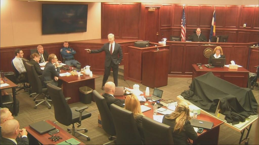 <p>District Attorney George Brauchler, center, points at defendant James Holmes on opening day of the Aurora theater shooting trial in Centennial, Colorado on Monday, April 27, 2015.</p>