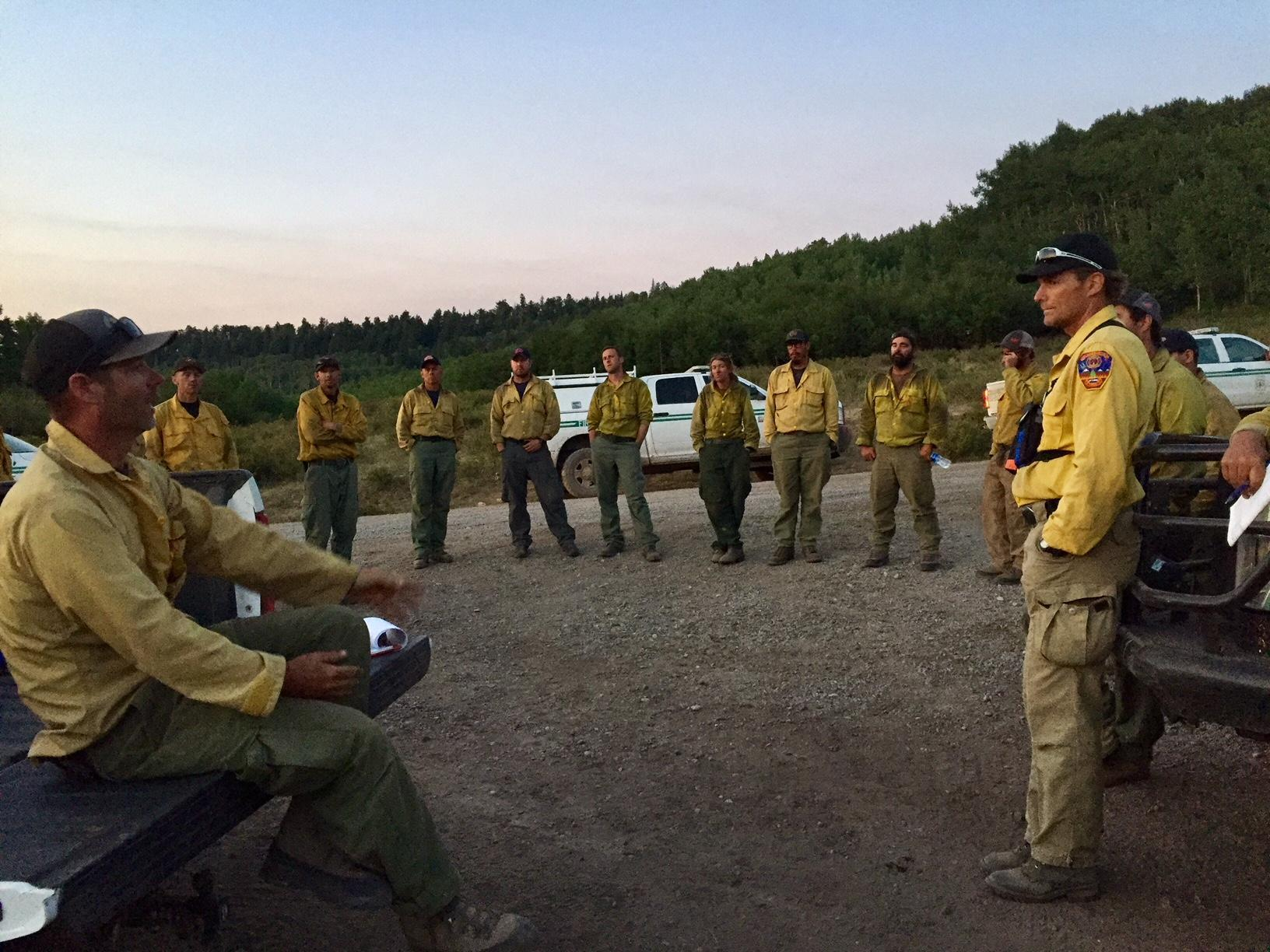 <p>Bull Draw Fire staff at a morning meeting on Aug. 17, 2018.</p>