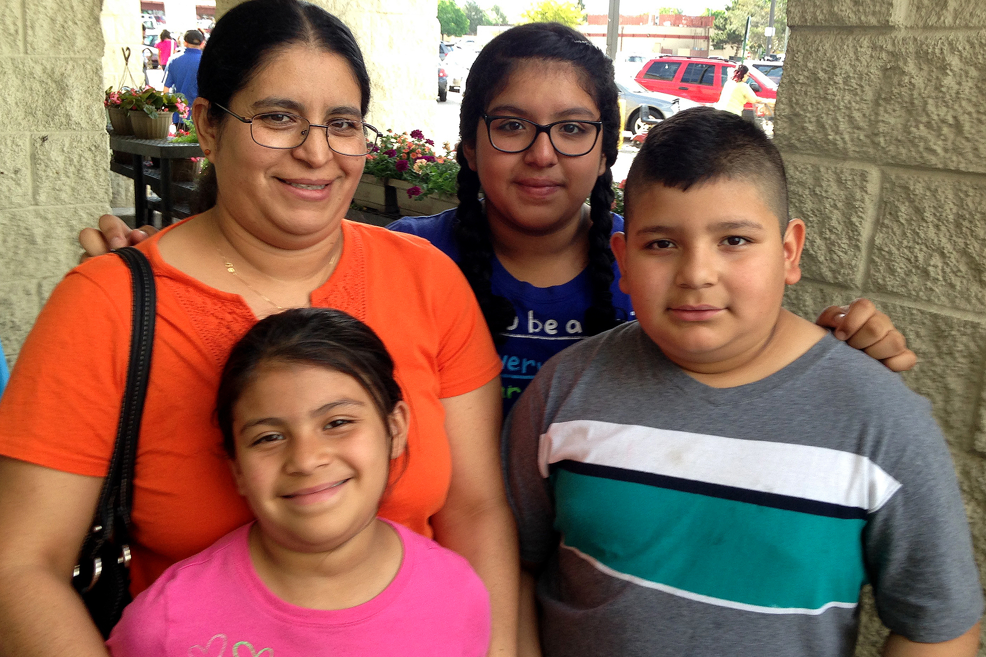 <p>Argelia Sanchez, with her children Yohely, Yaritza and Yovany, on a recent visit to a grocery story in Aurora, as part of the Rocky Mountain Youth Clinics Get Fit program.</p>