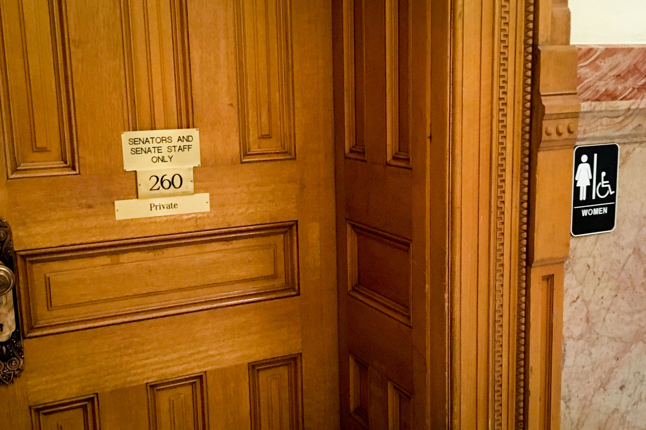<p>Previously, this door did not have a sign that indicated it led to a women's restroom. Officials installed the standard placard to the right of the door that now properly labels its designation.</p>