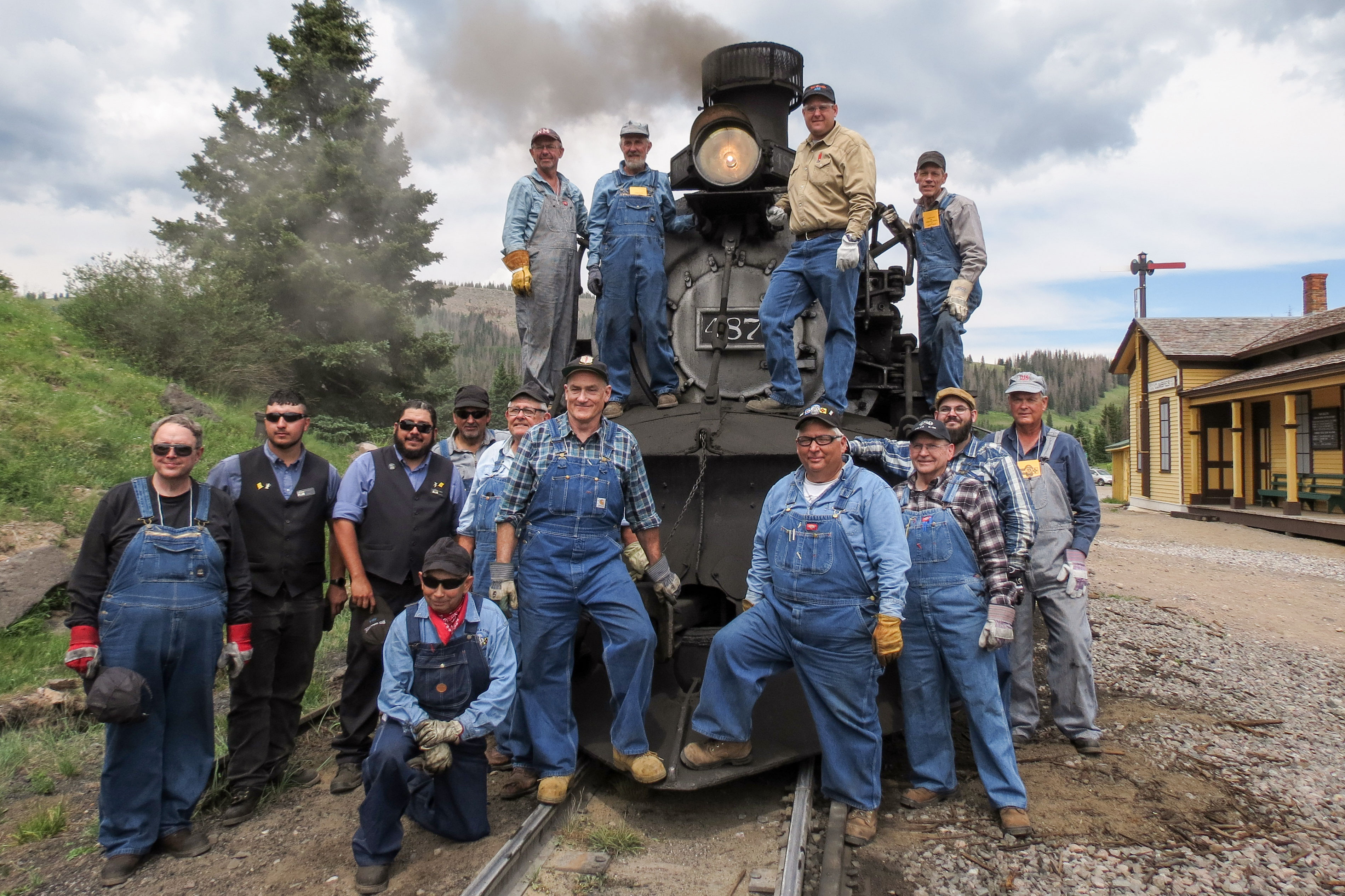 <p>The Cumbres & Toltec Scenic Railroad engineer and fireman school poses with instructors in front of the Engine 487 at the summit of Cumbres Pass in Colorado.</p>