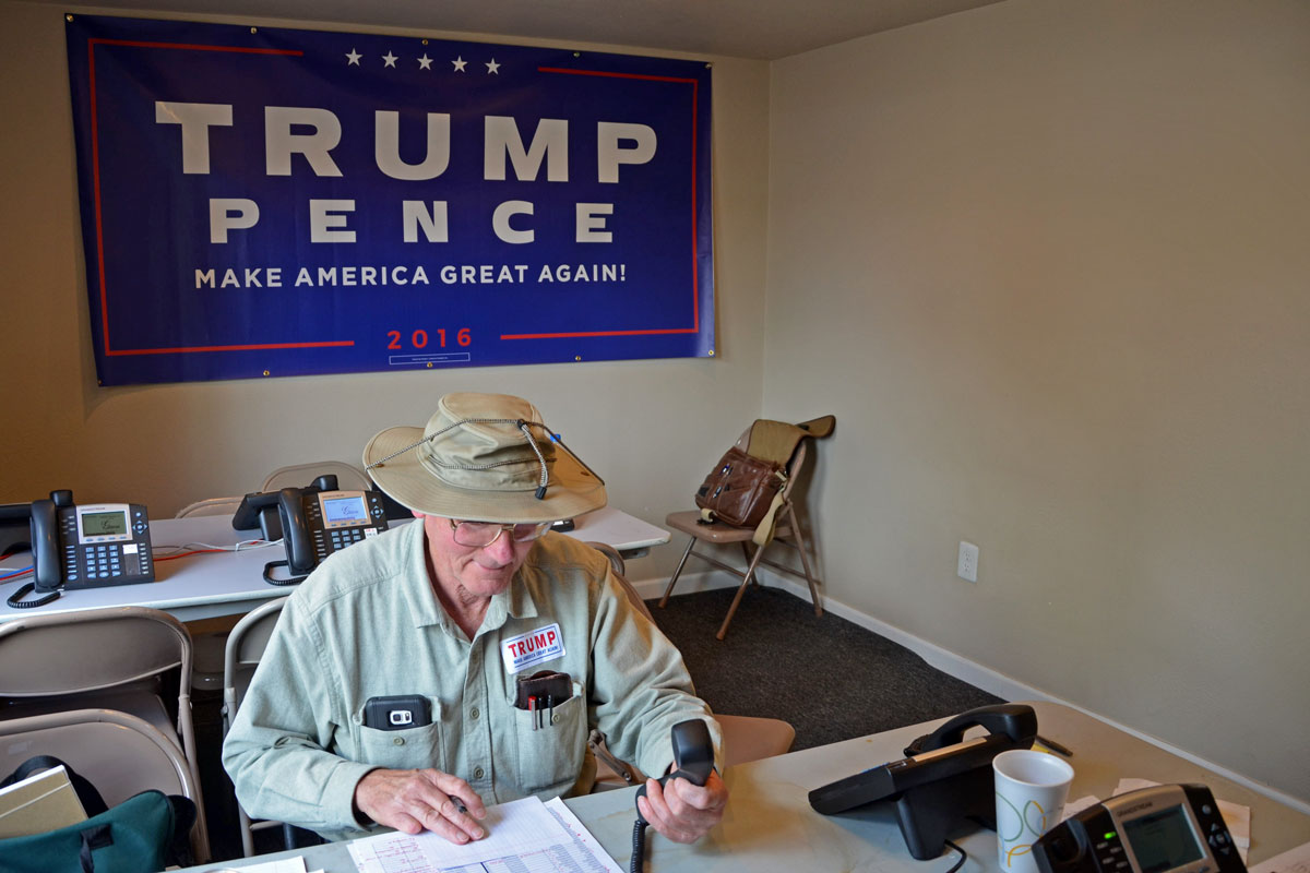 <p>A volunteer makes calls at the Republican campaign office in Lakewood in September, 2016.</p>