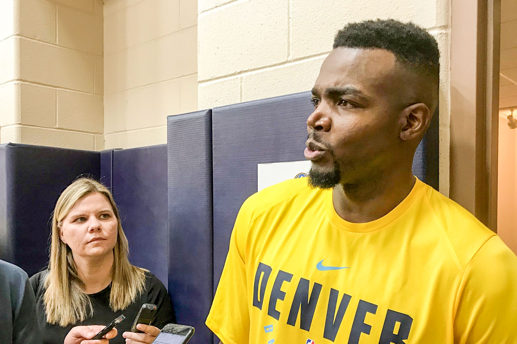 <p>Free agent Denver Nugget power forward Paul Millsap taking questions from reporters. The Denver Post's Gina Mizell is in the background.</p>