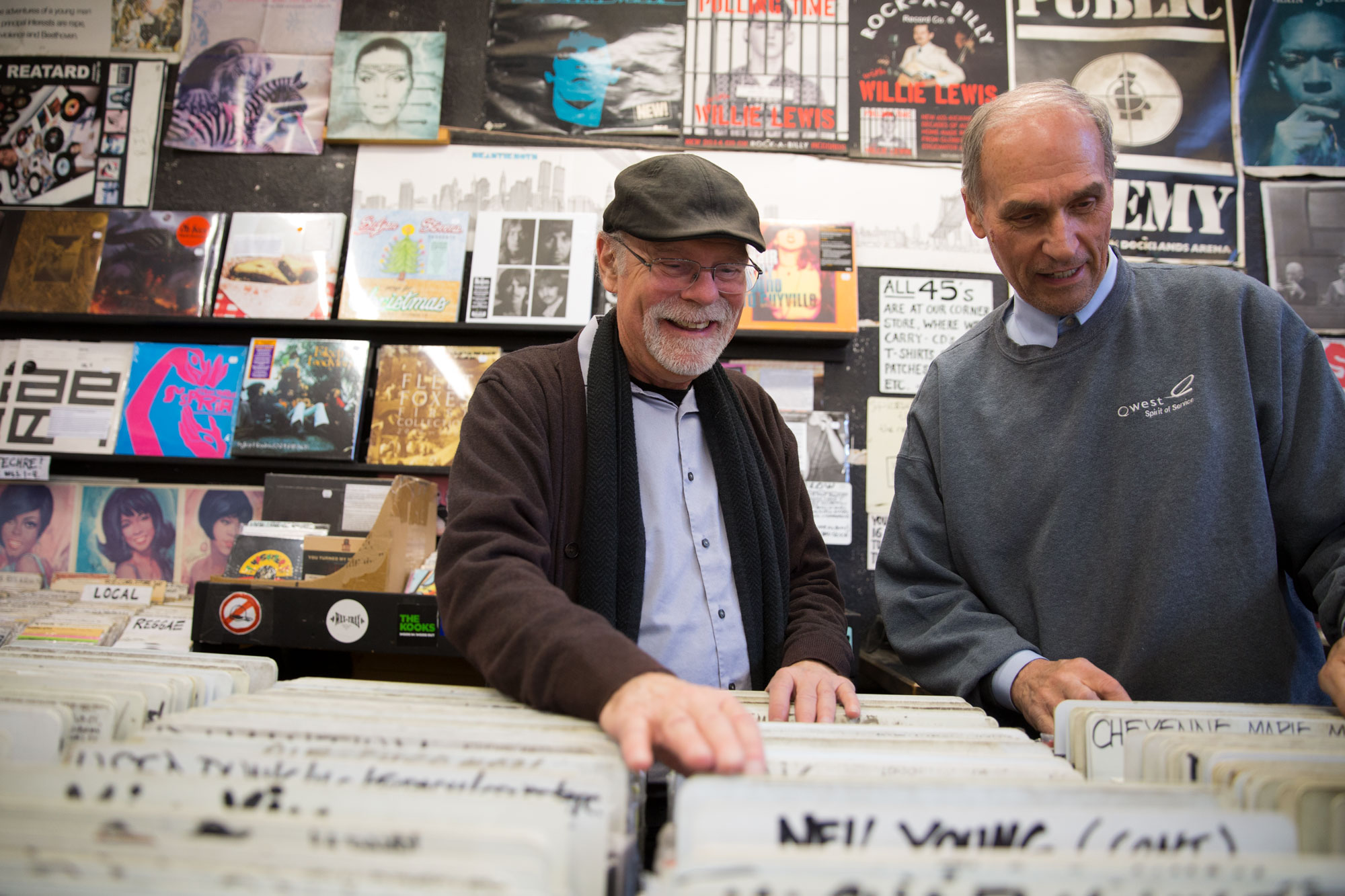 <p>Duane Davis (left) and Dave Stidman rifle through records at Wax Trax, the Capitol Hill record store mecca they've co-owned for 40 years, on Nov. 13, 2018.</p>