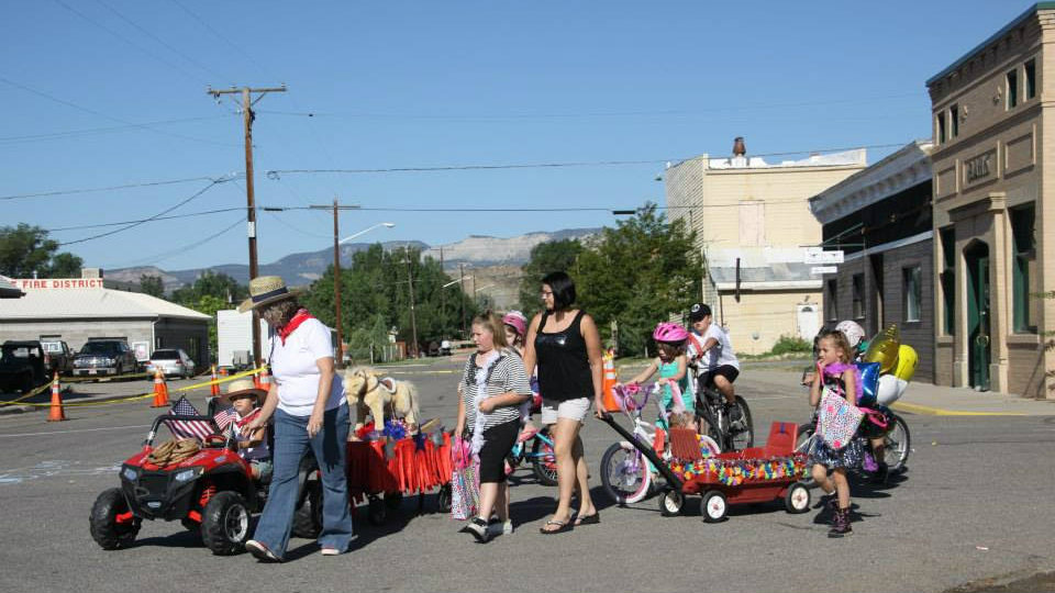 <p>Families attend the Wild Horse Day festivities in downtown DeBeque, Colo. </p>