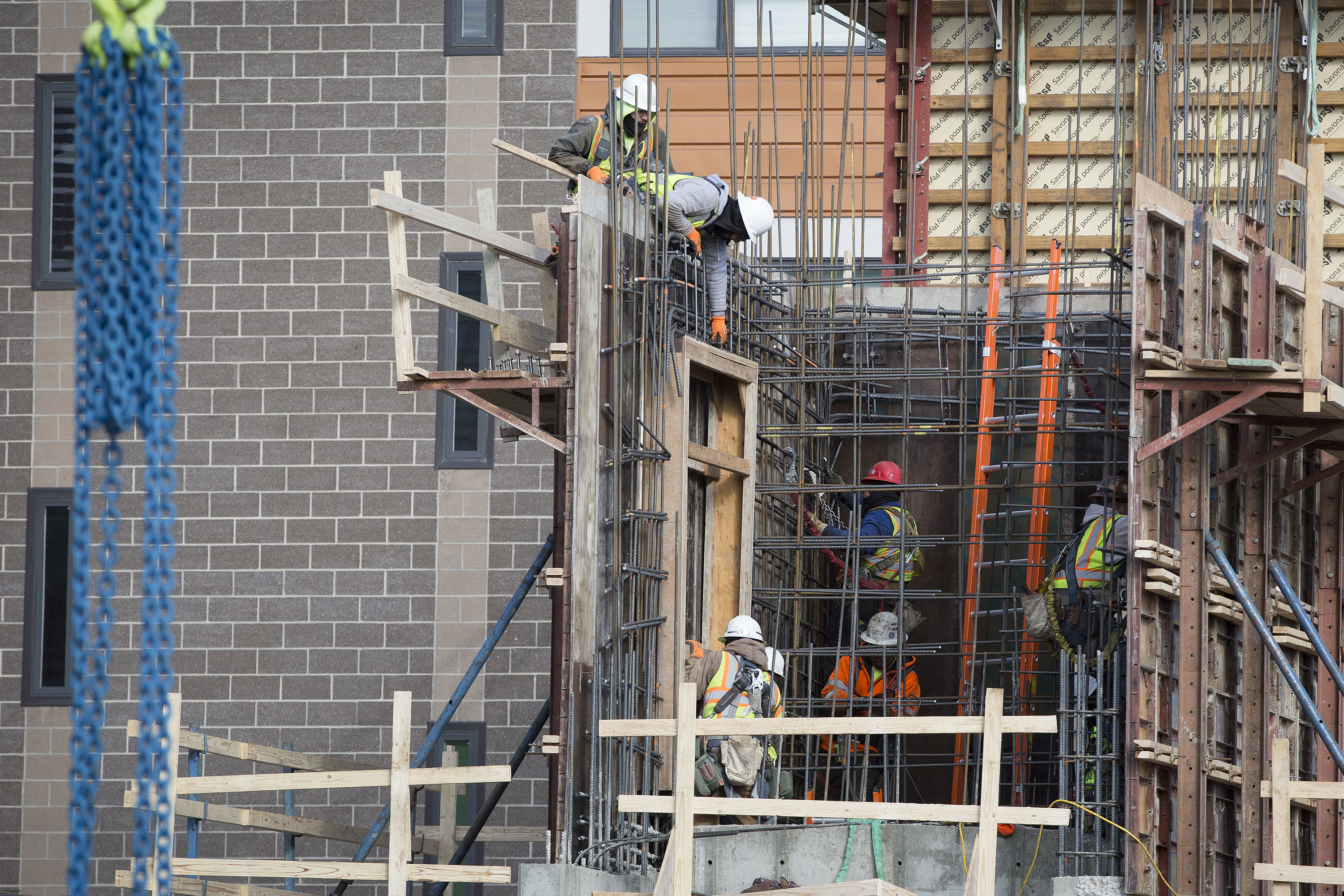 <p>Construction workers on a project in Denver's Lower Highlands neighborhood on Friday, Dec. 28. 2018.</p>