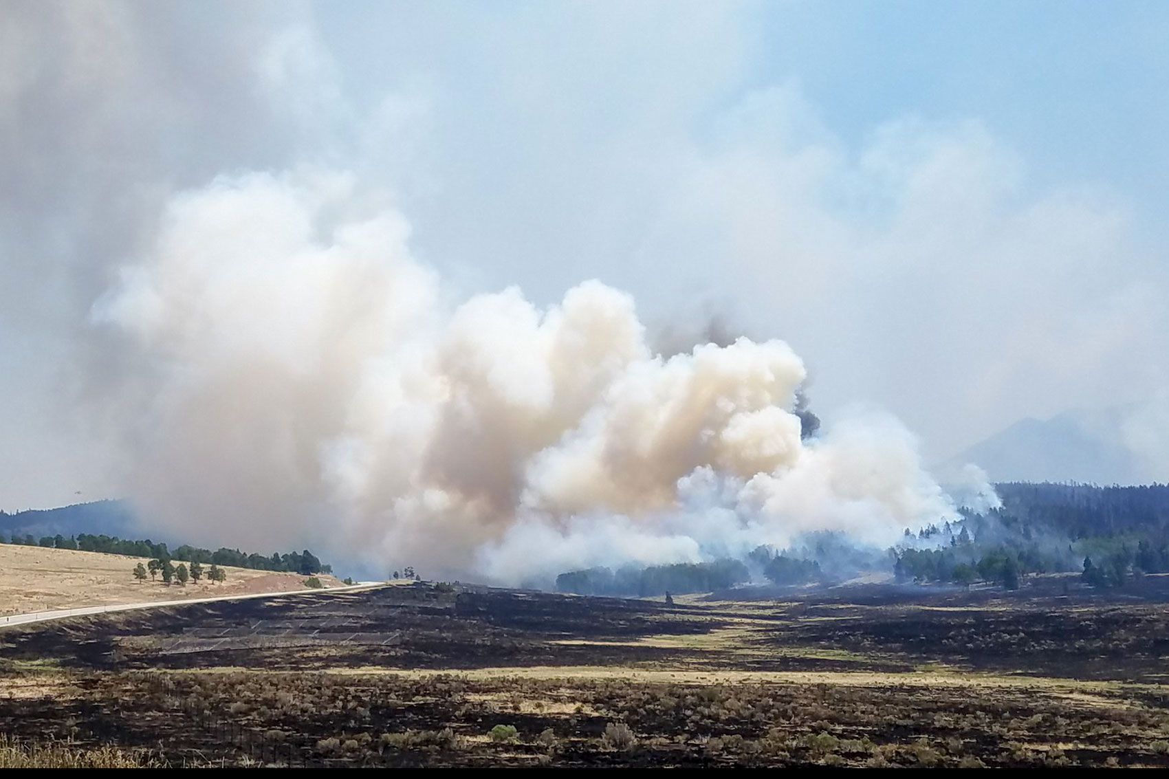 <p>The Spring Fire in Costilla County continues to burn. A crown fire on La Veta Pass, as seenSunday, July 1. The fire found an island of thick, unburned fuels.</p>