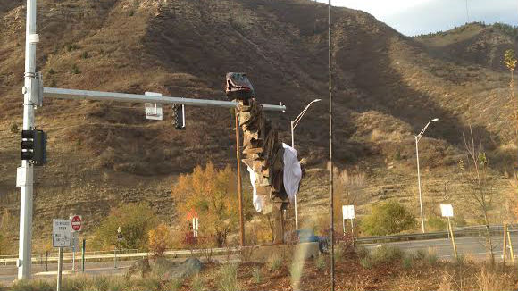 "<p>A dinosaur head mysteriously appeared on Halloween and then disappeared on Monday, Nov. 3 atop ""Arc of History,"" a controversial piece of public art in Durango.</p>"