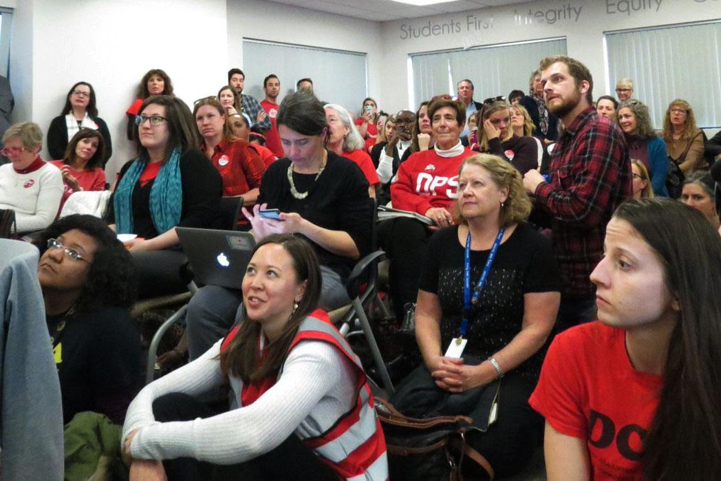 <p>Denver Public Schools teachers sit in the district's bargaining room on Thursday, Jan. 17.</p>