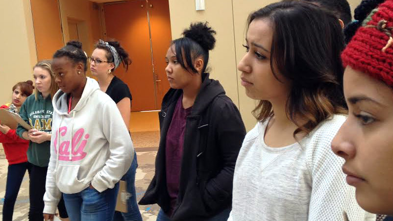 <p>Students from South High listen to a museum docent at the History Colorado Center talk about race and culture. </p>