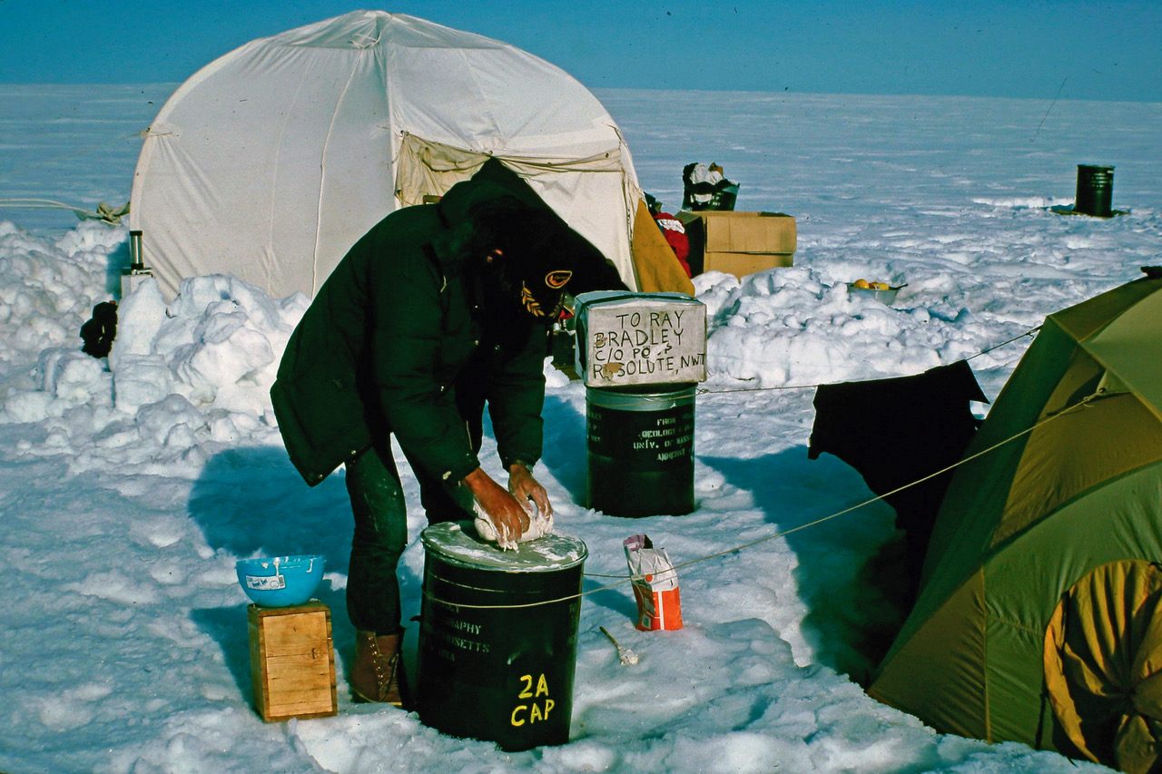 <p>A photo of Mark Serreze making bread by hand on Ellesmere Island in Northern Canada within the Arctic Circle in 1982.</p>