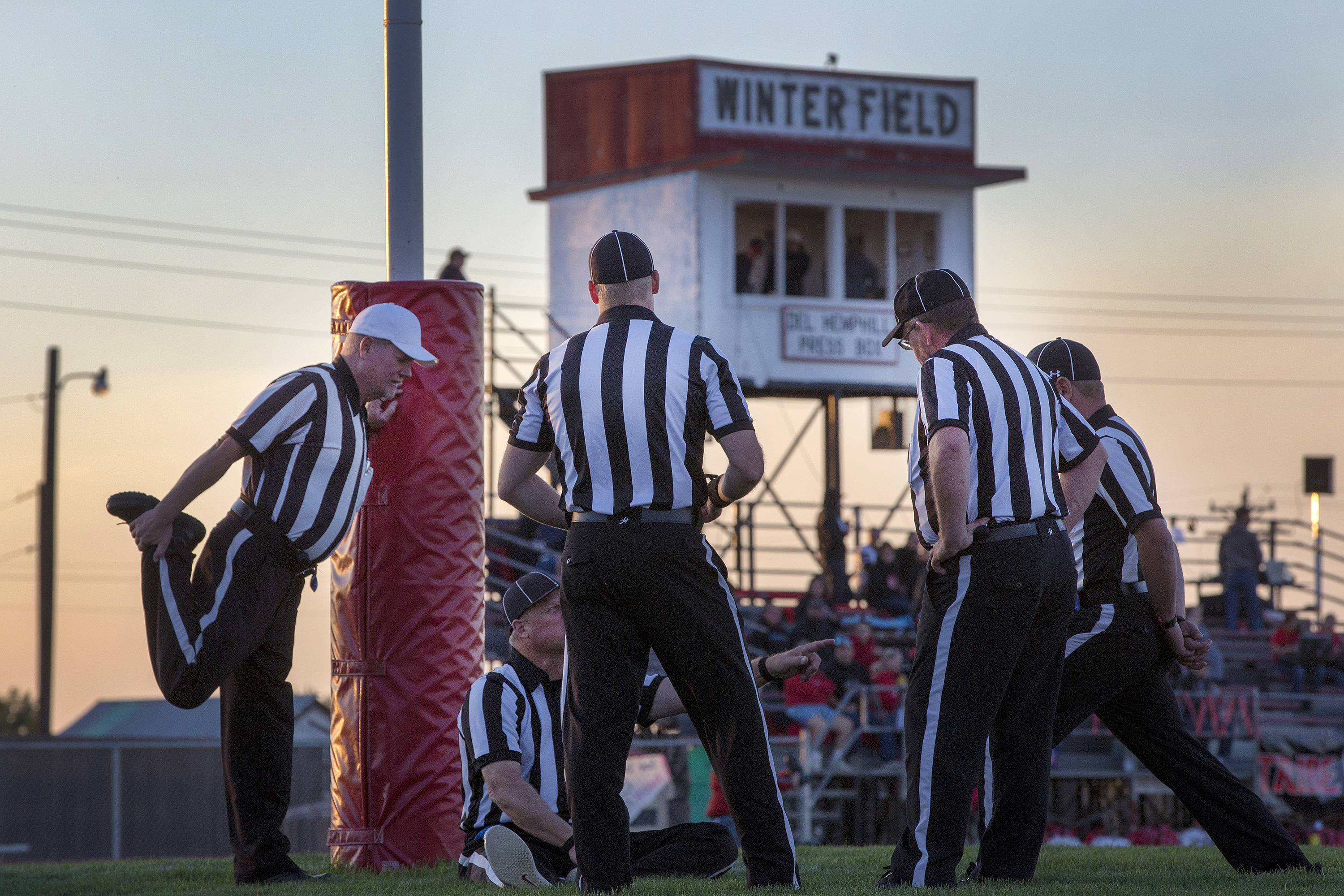<p>Referees warm up ahead of a Sept. 21 high school football match in Strasburg. The Indians were hosting the Limon Badgers.</p>