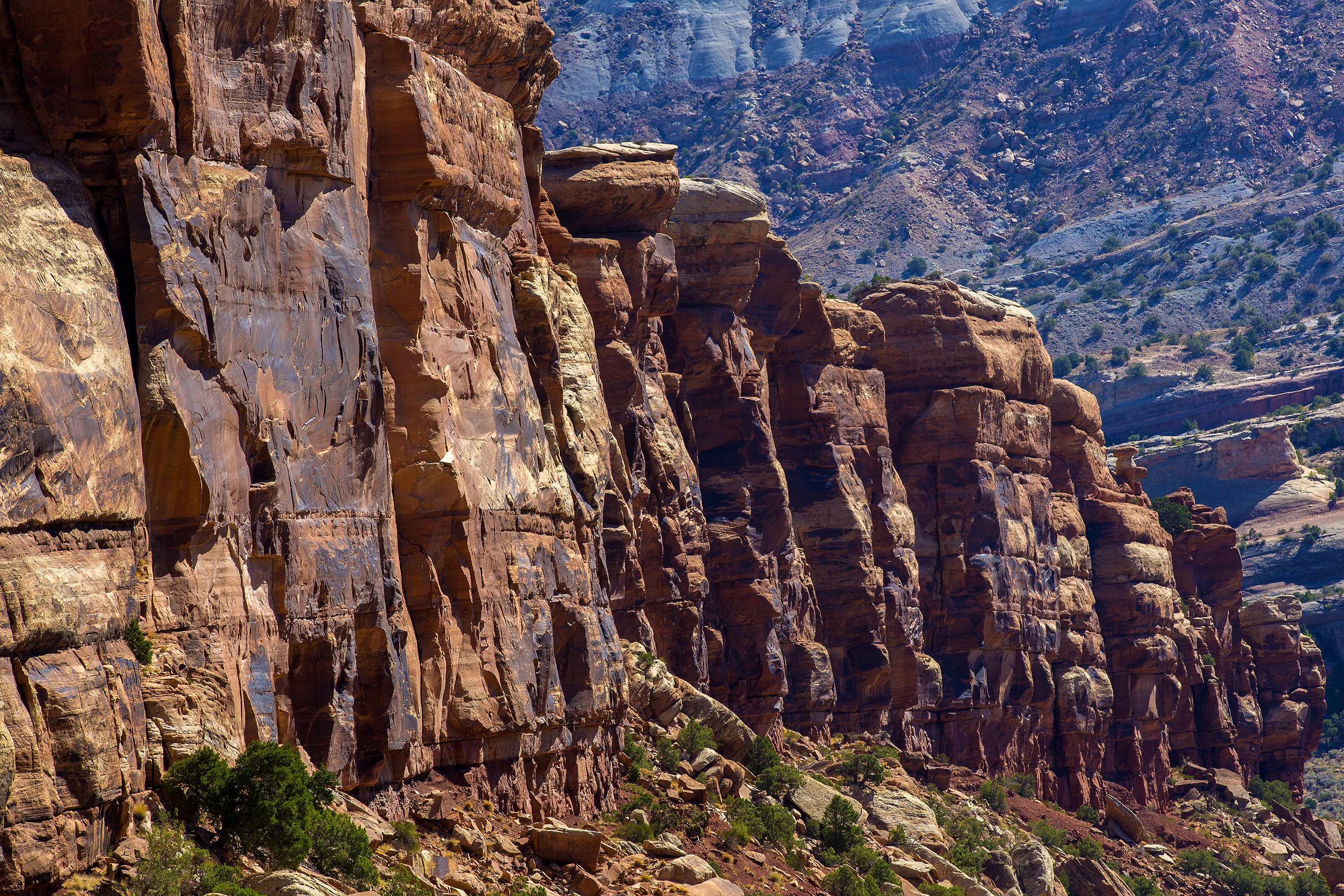 The towering red rock cliffs and spires of Colorado National Monument are just a few miles outside of Grand Junction -- public land close enough to enjoy up close and personally after a day at work for anyone in the city so inclined. This is a view from Red Canyon Overlook on Rim Rock Drive, on the way up from the East Entrance.