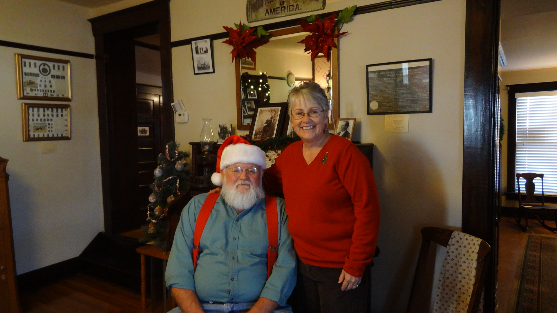 <p>Terry and Dee Ann Blevins welcome visitors to the Hedlund House Museum in Hugo, one of the stops on Lincoln County's Christmas on the Plains tour, Sunday, Dec. 3.</p>