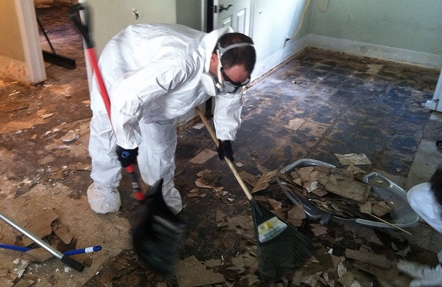 <p>Colby Pearce of Boulder cleans up after September's flooding.</p> <p></p> <p></p>