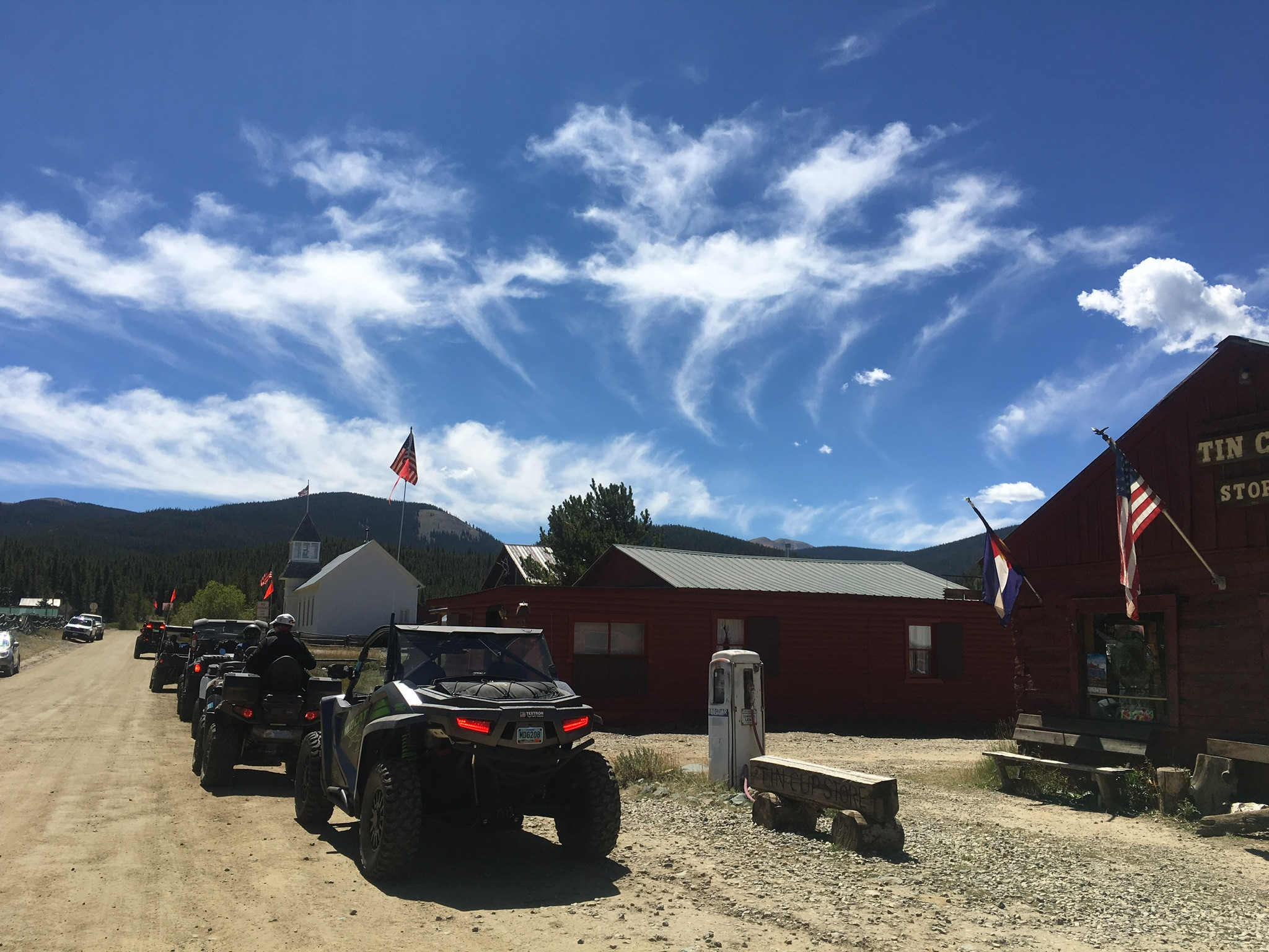<p>ATVs line up on a road in Tin Cup, a small mining town in Gunnison County.</p>