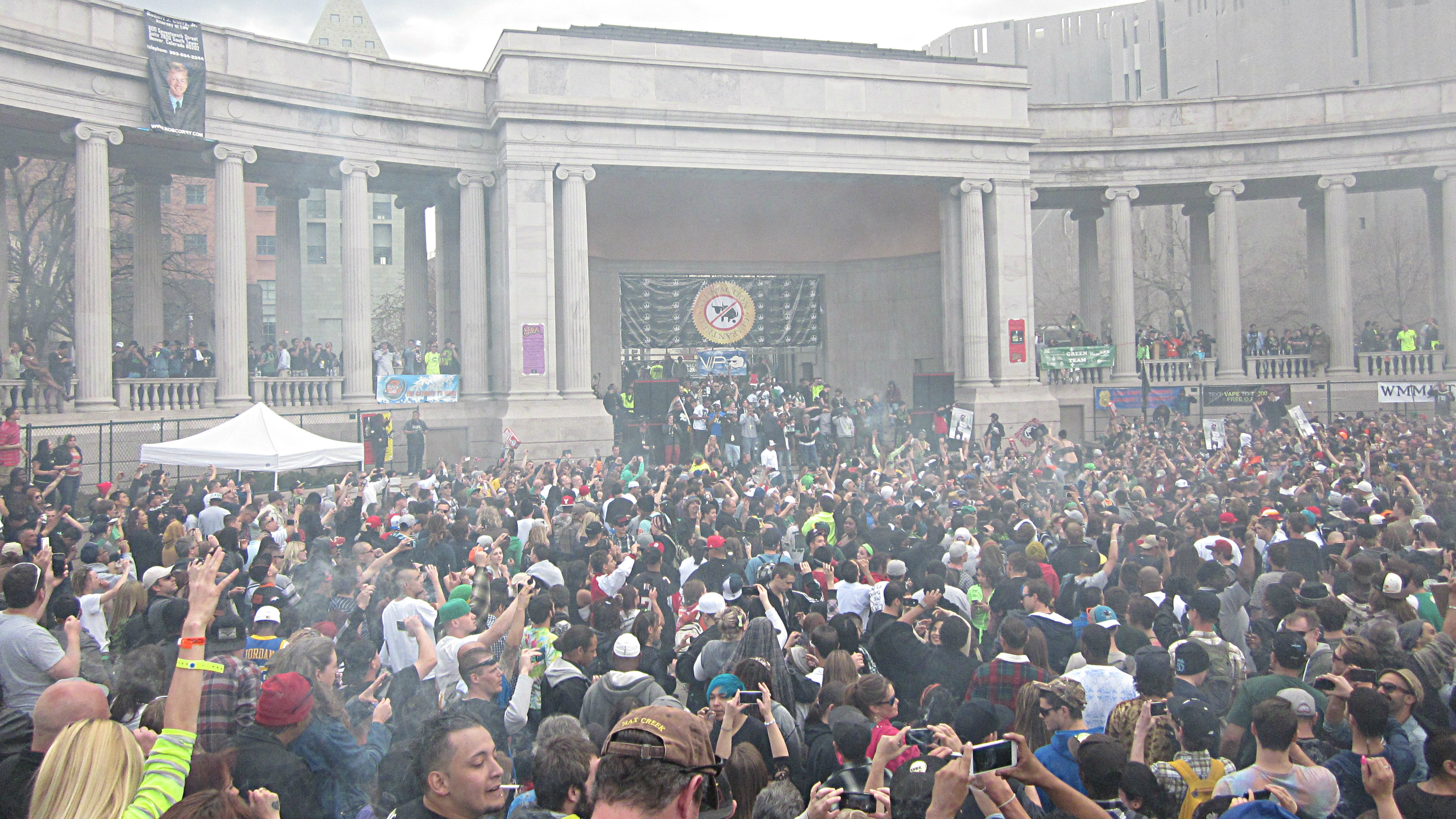 <p>A cloud of marijuana smoke rises from the annual 4/20 celebration in Denver. About 100,000 people came to Civic Center to celebrate in April.</p>