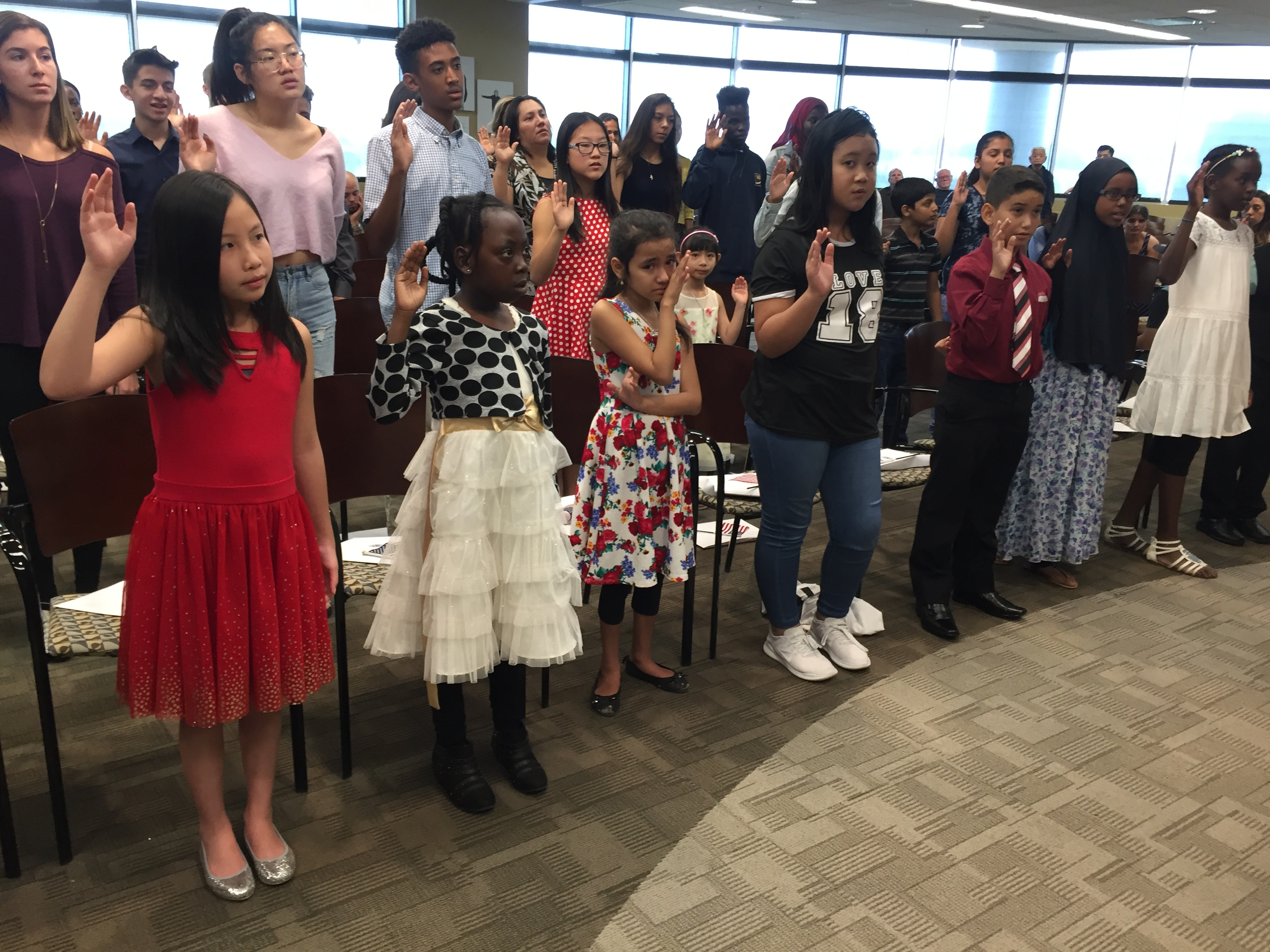 <p>More than 30 children, and a few grown-ups,from 18 countries received their citizenship certificates Aug. 24, 2018.</p>