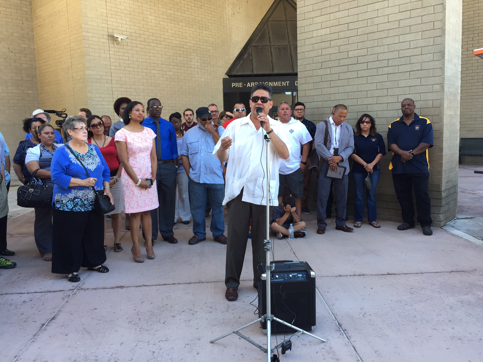 <p>Rudy Gonzales, flanked by representatives from othercivil rights groups, speaks about the need for community representation in the Denver Sheriff Department reform team.</p>