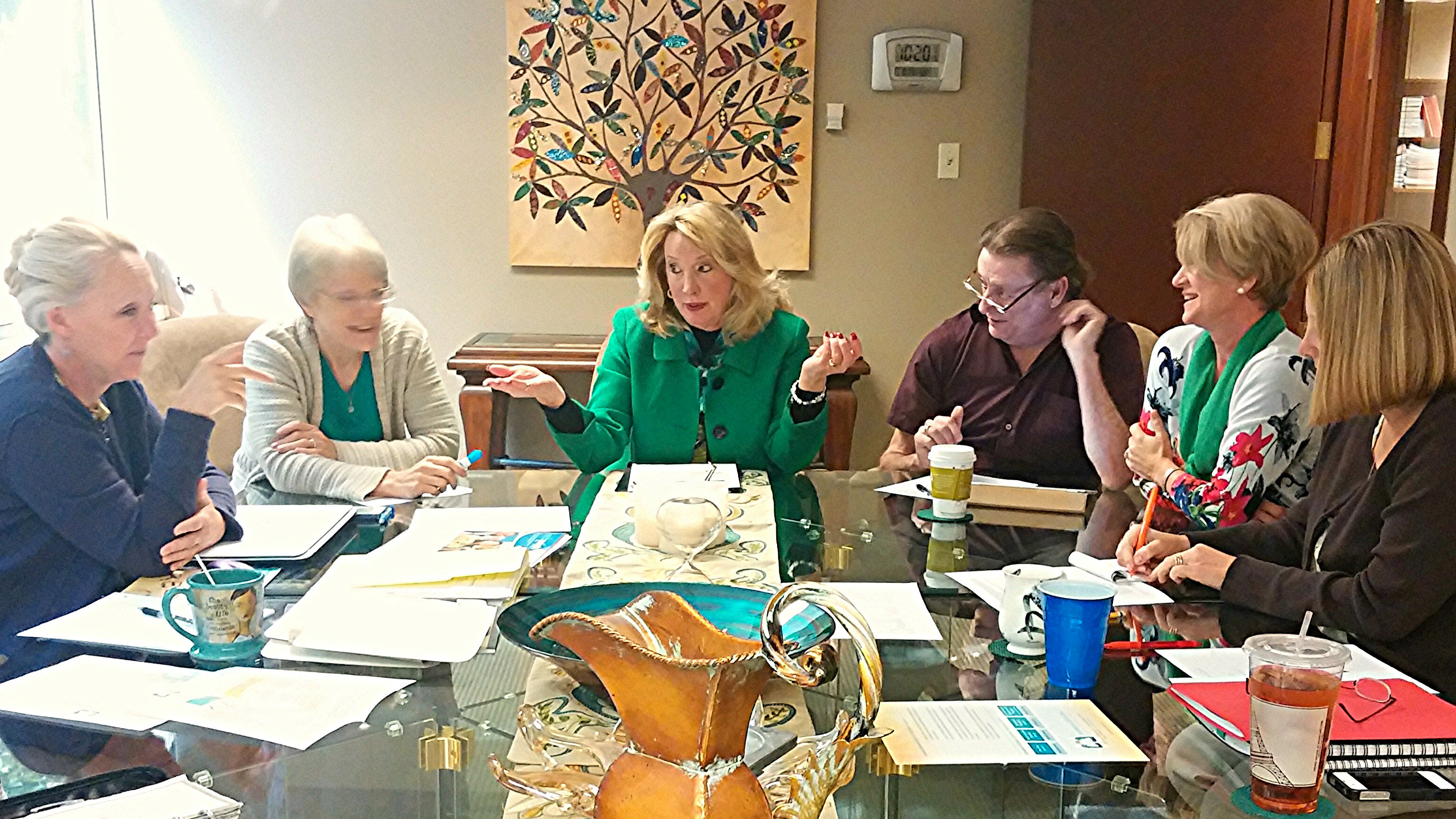 """<p>The CEO of the Institute of Life and Care in Greenwood Village<span style=""""line-height: 1.66667em;"""">Nancy Markham Bugbee (center)</span><span style=""""line-height: 1.66667em;"""">meets with other faculty at the institute.</span></p>"""