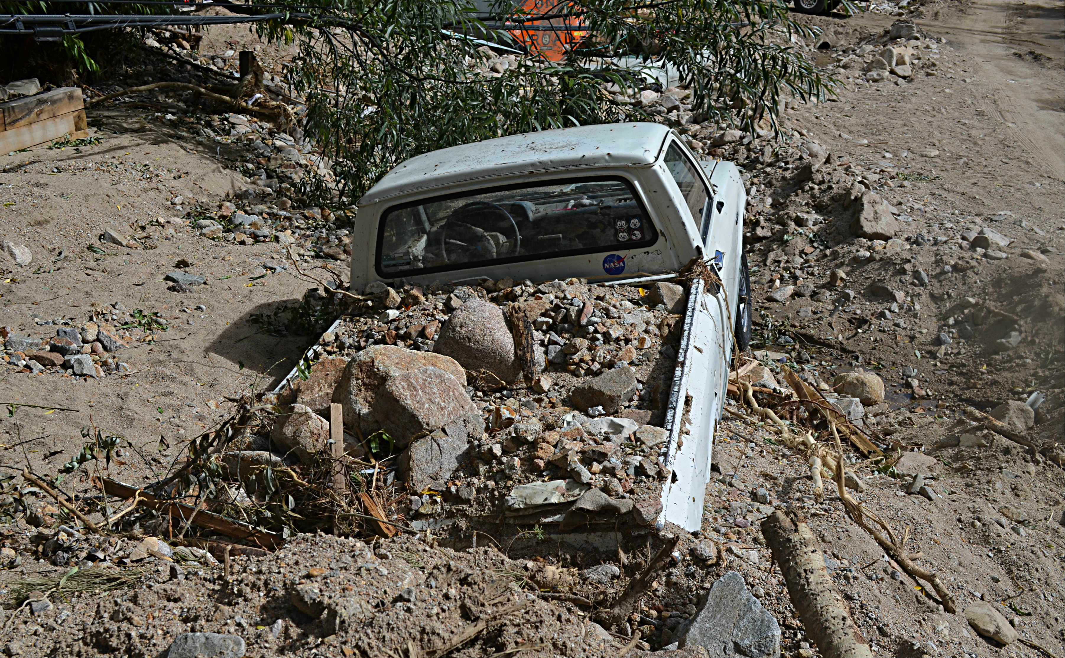 <p>Silt from flooding surrounds a resident's truck in hard-hit Jamestown, Colorado.</p>