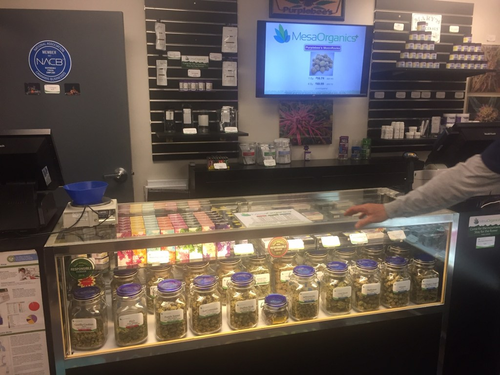 A display shelf inside Jim Parco's dispensary, Mesa Organics, adjacent to his cannabis extraction facility, Purplebee's, in Pueblo, CO