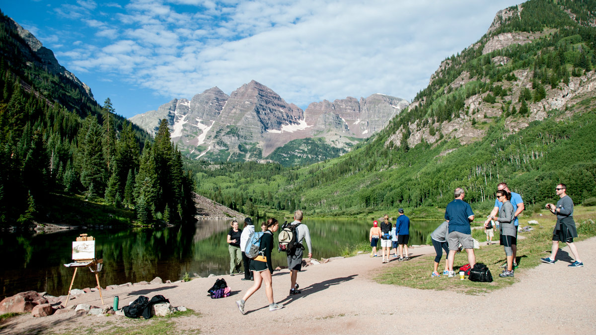 <p>Hikers, artists and day trippers arrive early in the morning at Maroon Lake near Aspen.</p>